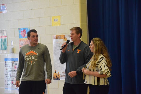UT football players Riley Lovingood and Joe Doyle along with teacher Savanna Bartram wish Sheila Earl a happy retirement during her retirement assembly held at Karns Elementary School Tuesday, April 9, 2019.