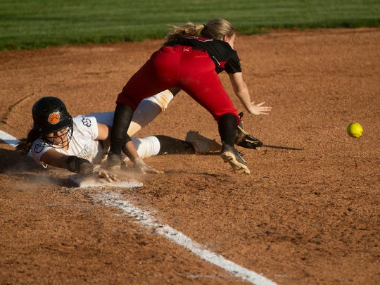 Powell's Hayden Dye (4) makes it safely to third under Central's Haley Carr (9) on Thursday, April 11, 2019.