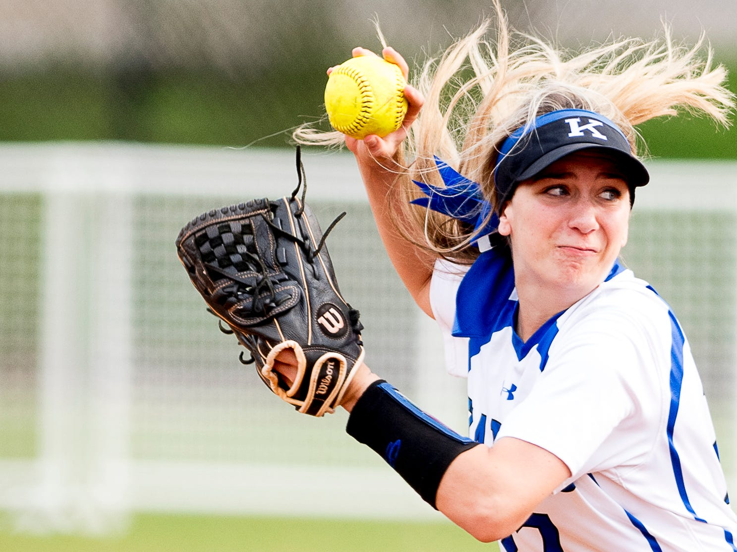 Karns' Jennifer Bezarek (27) throws the ball to first during a softball game between Catholic and Karns at Caswell Park in Knoxville, Tennessee on Friday, April 12, 2019.