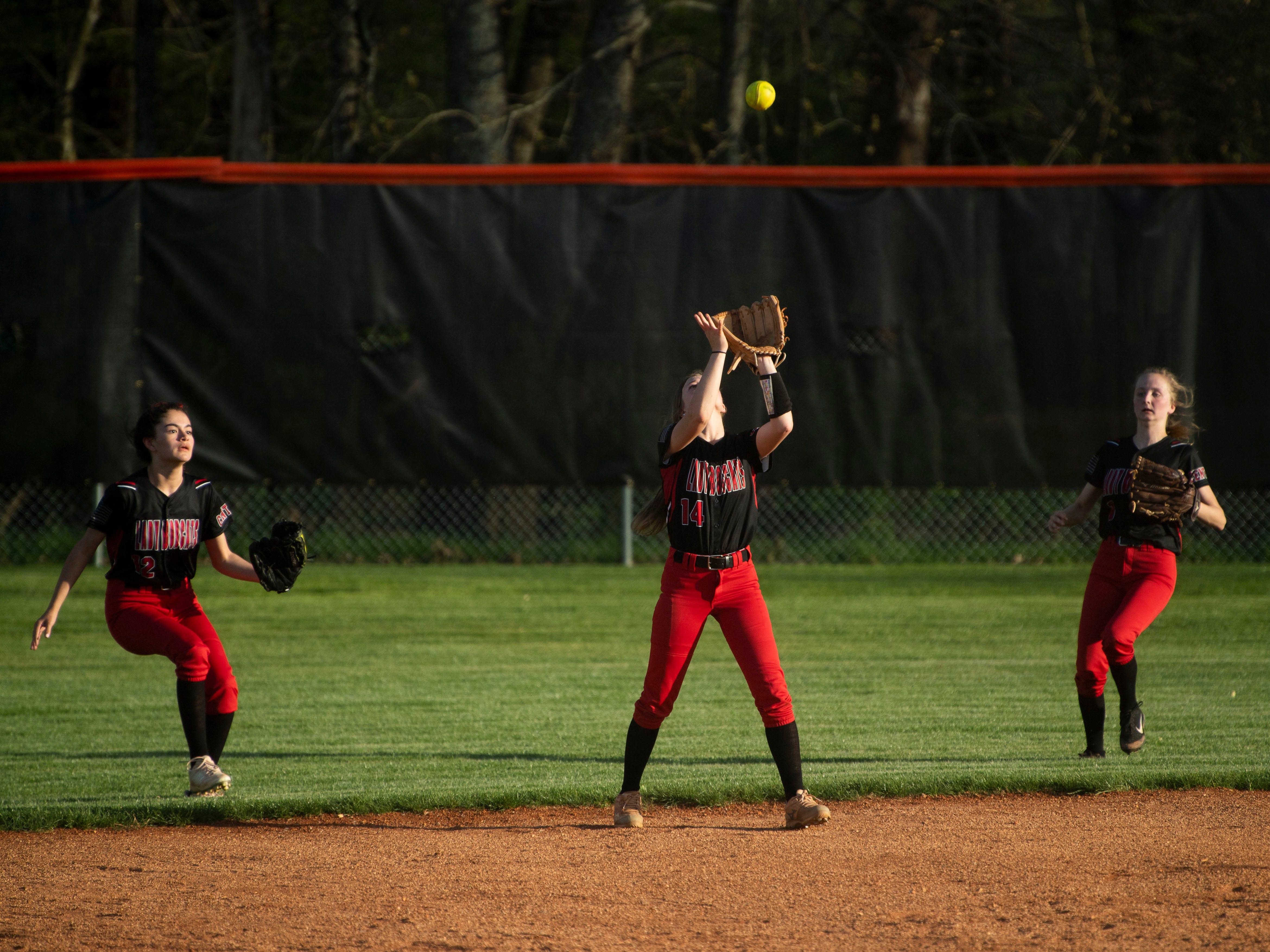 Central's Maycee Limbaugh (14) catches the fly ball in the game at Powell on Thursday, April 11, 2019.