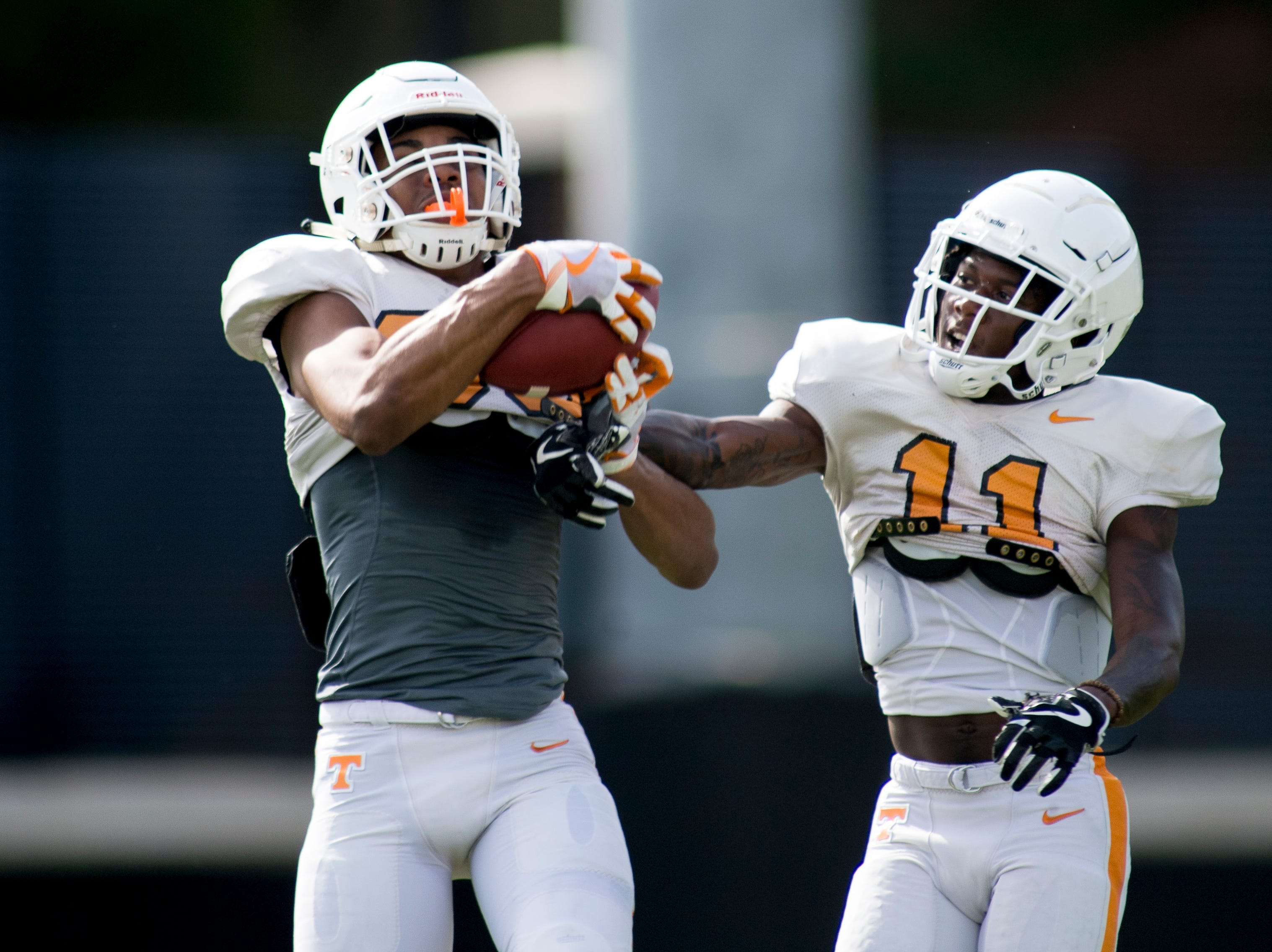 Tennessee's Tennessee's Cedric Tillman (85) and Jordan Murphy (11) catch a pass during Tennessee spring practice at Haslam Field in Knoxville, Tennessee on Thursday, April 11, 2019.