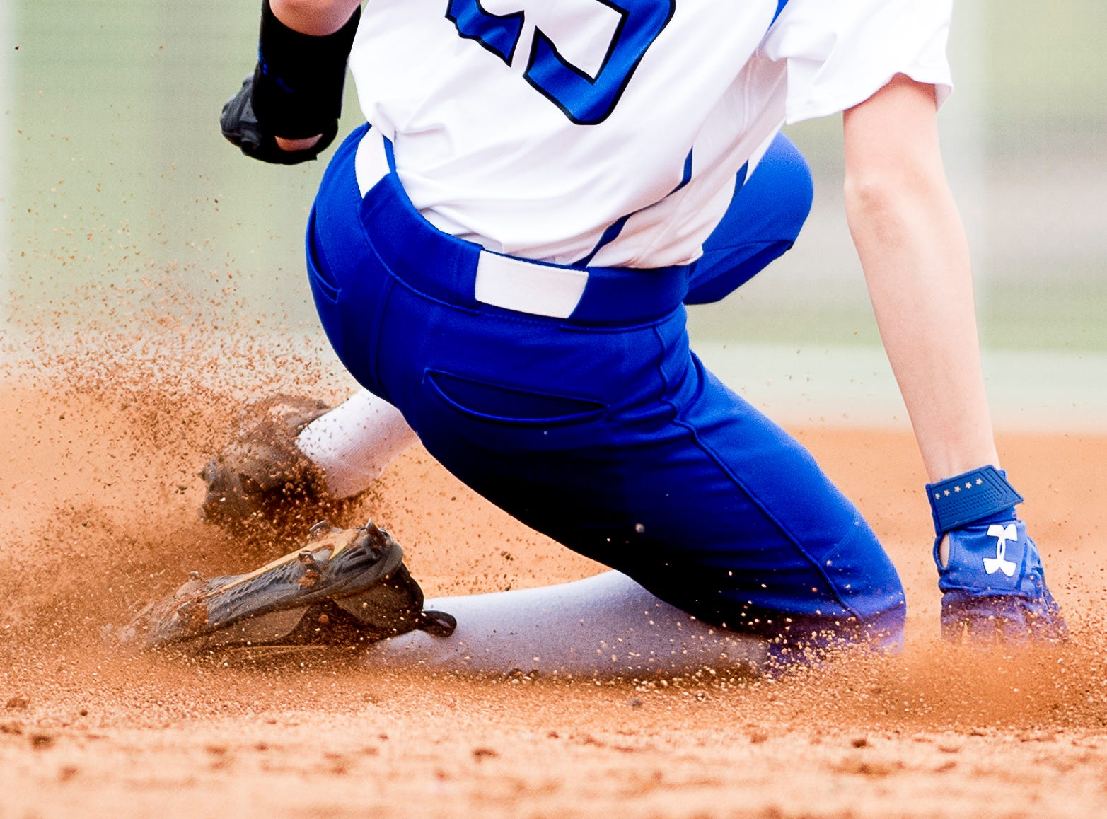 A Karns player slides into second base during a softball game between Catholic and Karns at Caswell Park in Knoxville, Tennessee on Friday, April 12, 2019.