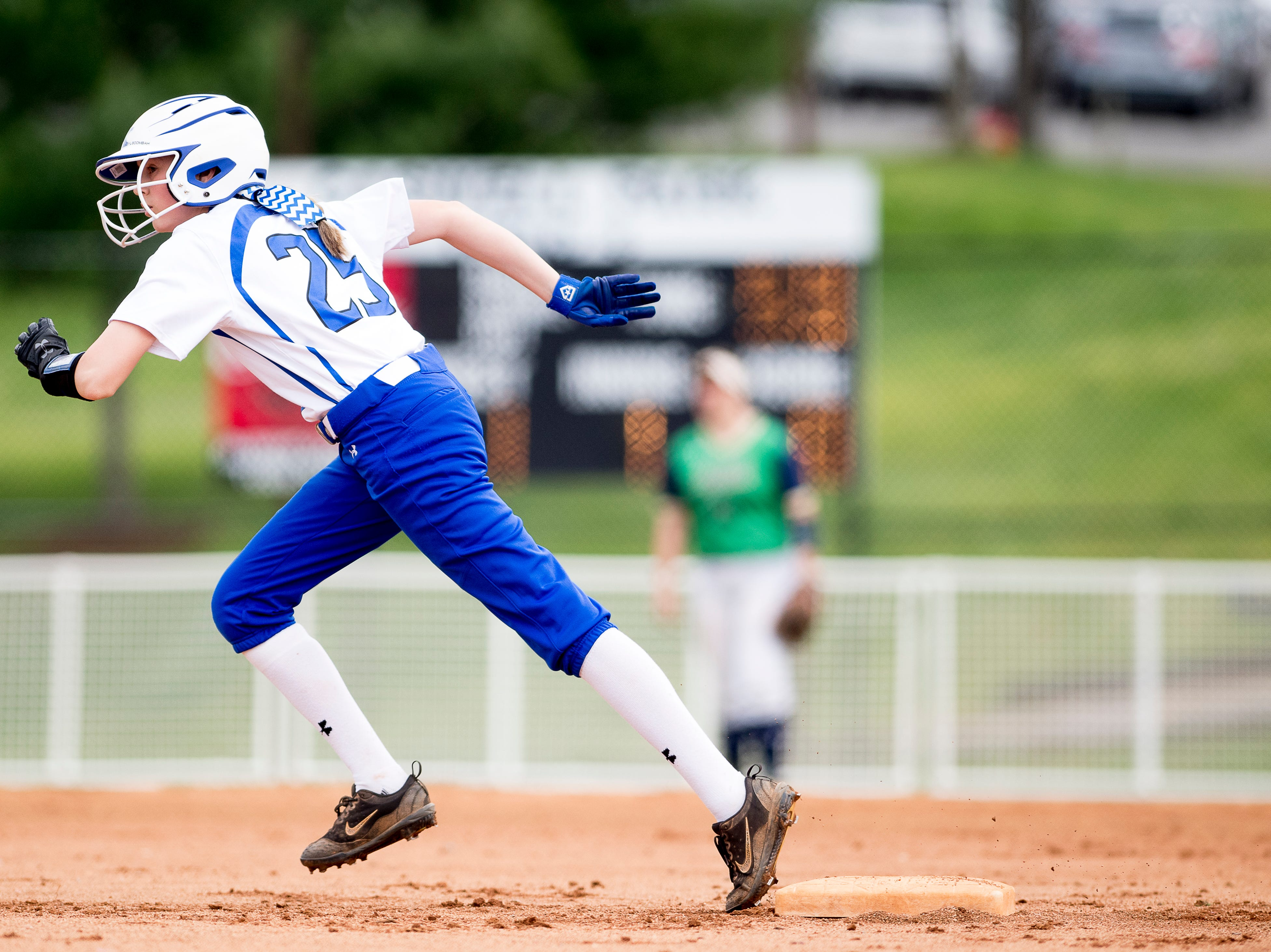 Karns' Elizabeth Breeden (25) runs to third during a softball game between Catholic and Karns at Caswell Park in Knoxville, Tennessee on Friday, April 12, 2019.