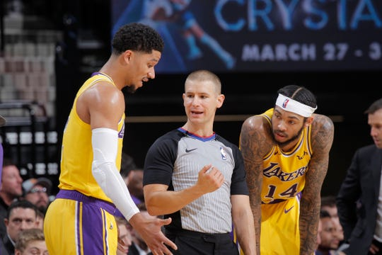 NBA referee Tyler Ford talks to Josh Hart of the Los Angeles Lakers during the game against the Sacramento Kings on December 27, 2018 at Golden 1 Center in Sacramento, California.