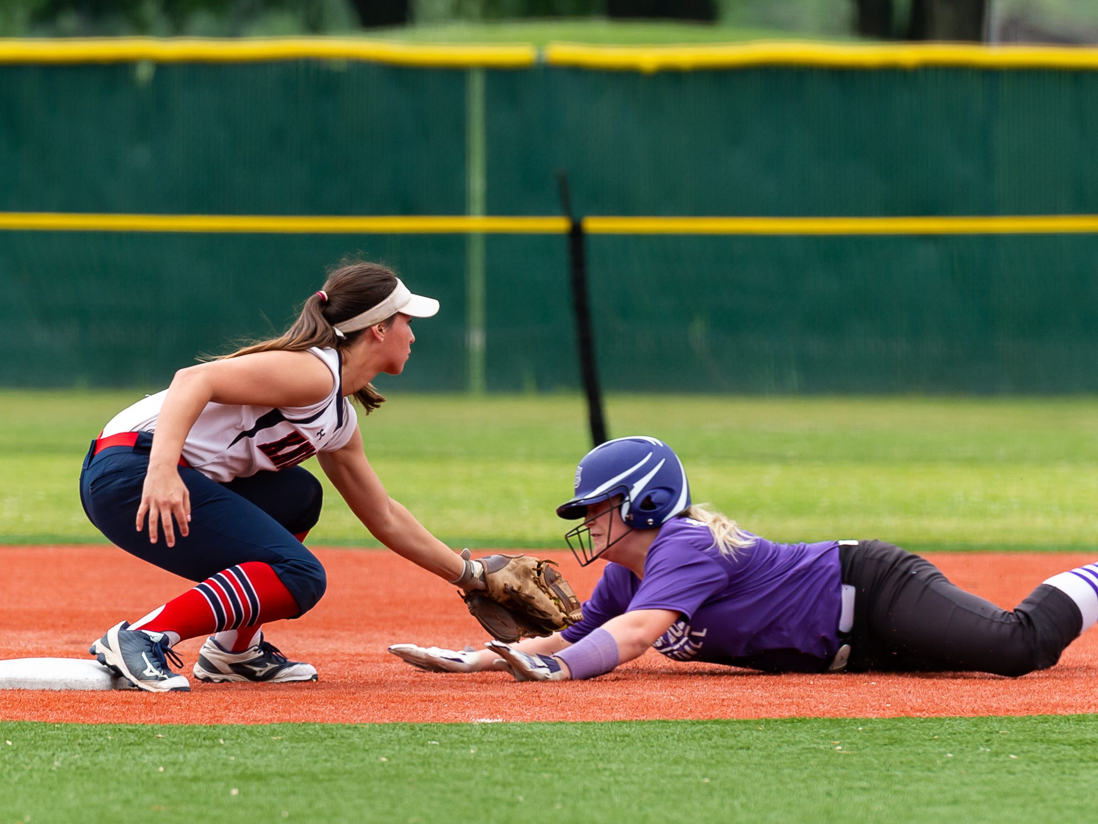 Shortstop Sarah Diaz lays down the tag for the out as  Lafayette Christian Academy softball takes on University Academy in the forst round of the LHSAA playoffs. Friday, April 12, 2019.
