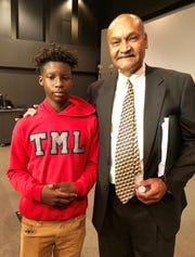 Seventh-grader Tyler Davis and grandfather Greg Davis attend a press conference about Tyler's school, T.M. Landry College Preparatory School. The elder Davis is board president and spokesman for the school, which recently moved to Lafayette.