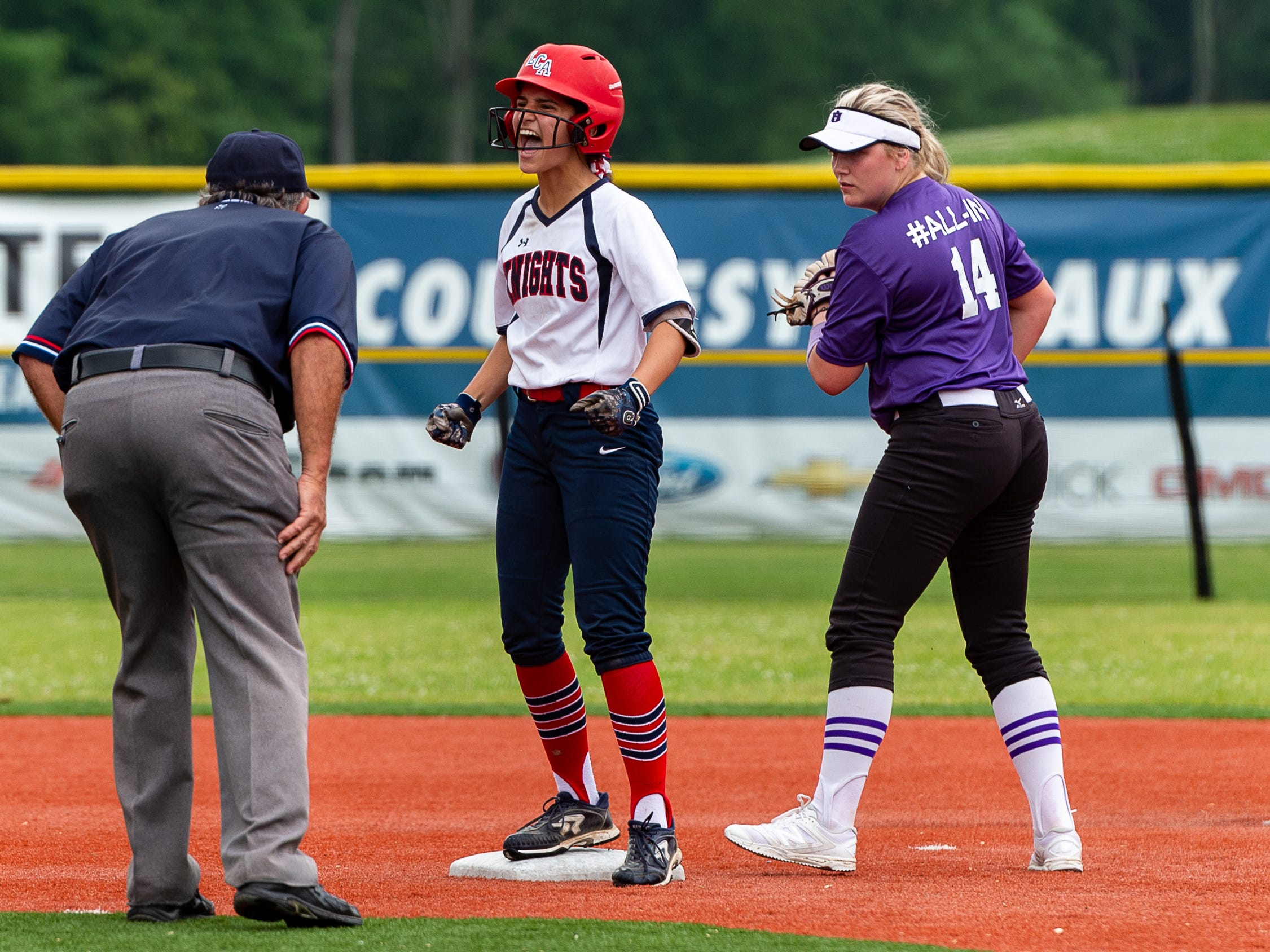 Janci Aube' stands on second after hitting a double as Lafayette Christian Academy softball takes on University Academy in the forst round of the LHSAA playoffs. Friday, April 12, 2019.