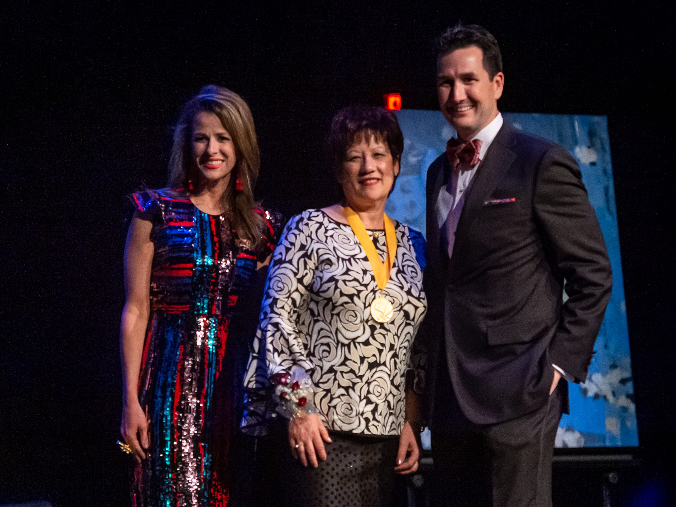 Vergie Banks is presented the Visual Artist Award by Aimee Cotter and Blake David at The 2019 Icon Arts & Cultural Awards Gala honoring Acadiana's Legends. Thursday, April 11, 2019.