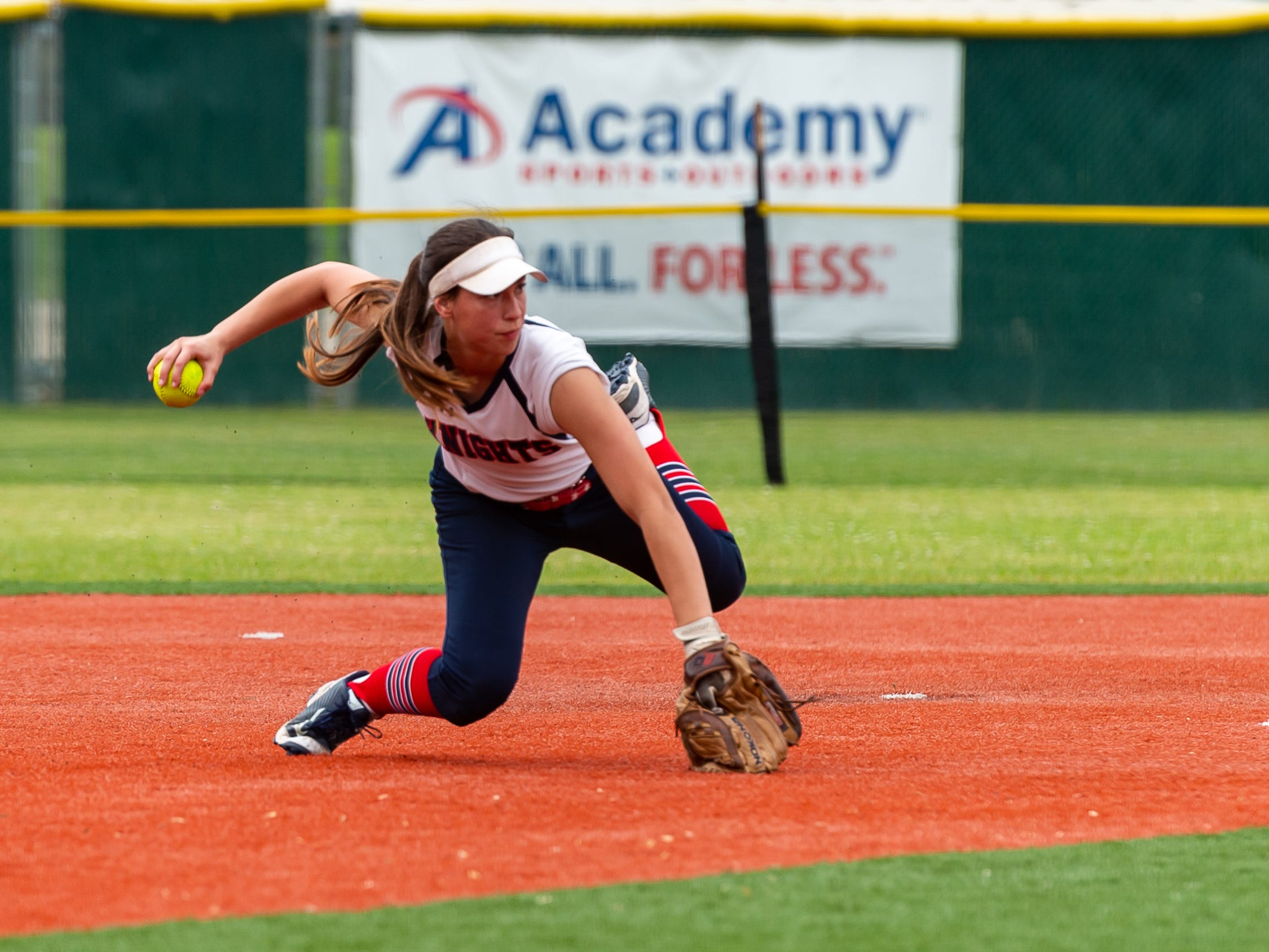 Shortstop Sarah Diaz comes up with the ball and fires down to first as  Lafayette Christian Academy softball takes on University Academy in the forst round of the LHSAA playoffs. Friday, April 12, 2019.