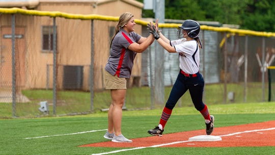 Stevie Credeur gives a hi five to Head Coach Taylor Leger after hitting a home run as Lafayette Christian Academy softball takes on University Academy in the forst round of the LHSAA playoffs. Friday, April 12, 2019.
