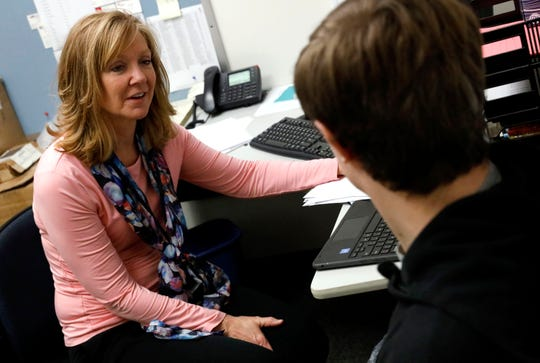 Renee Theiss, the career readiness program coordinator at Lancaster High School, talks to senior Dakota Ooten Tuesday, Nov. 4, 2018, in the career technology building at Lancaster High School. Theiss, a former LHS guidance counselor, is working with students at the school to guide them through the Lancaster 33 Alliance's career readiness diploma certification. Successful completion of the program ensures a graduating senior an interview with participating local employer.