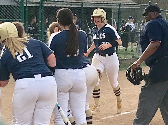 Lancaster's Abbie Wilfing is greeted by her teammates after she hit a three-run home run in the Golden Gales' 9-0 win over Pickerington Central on Thursday.