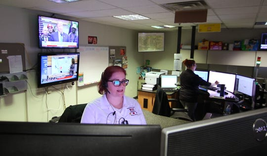 Livingston County 911 dispatcher Leslee Loafman-Cummings handles a call Friday, April 12, 2019 at the facility in Howell.