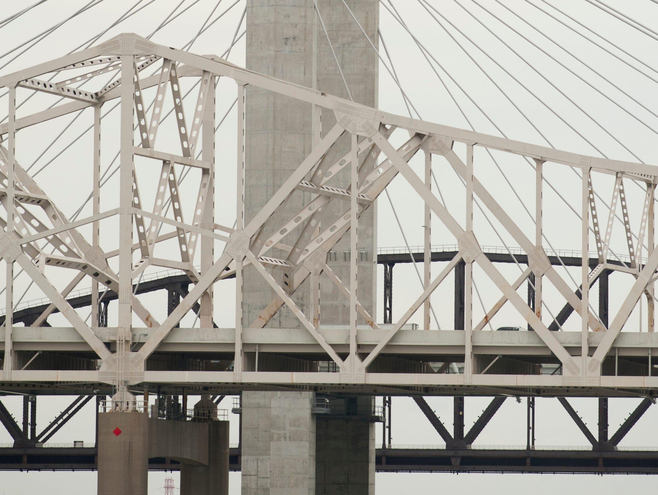 A plane flies over the I-65 bridge.12 April 2019