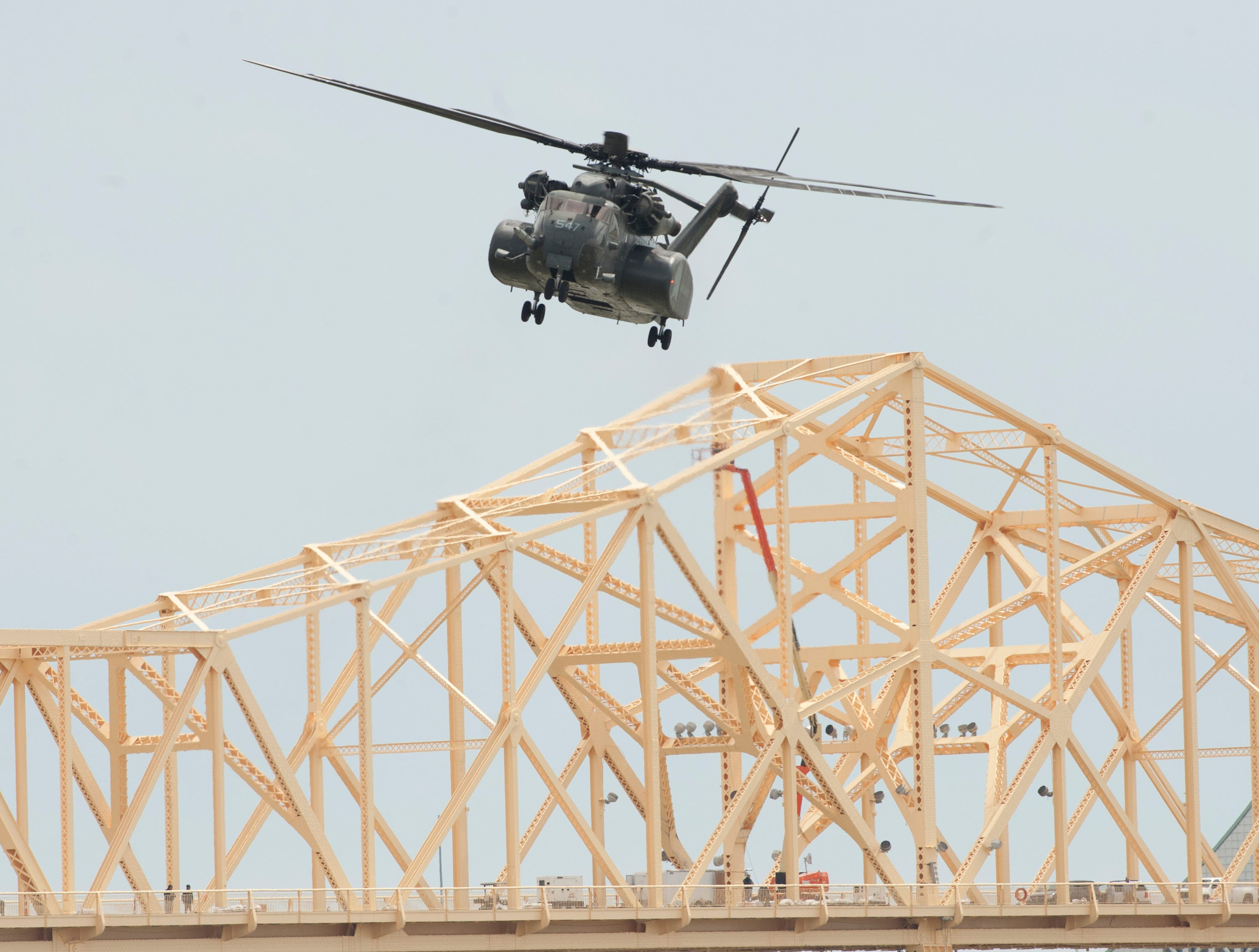 A U.S. Navy Vanguard helicopter hovers over the Second Street Bridge as it practices for the air show.12 April 2019