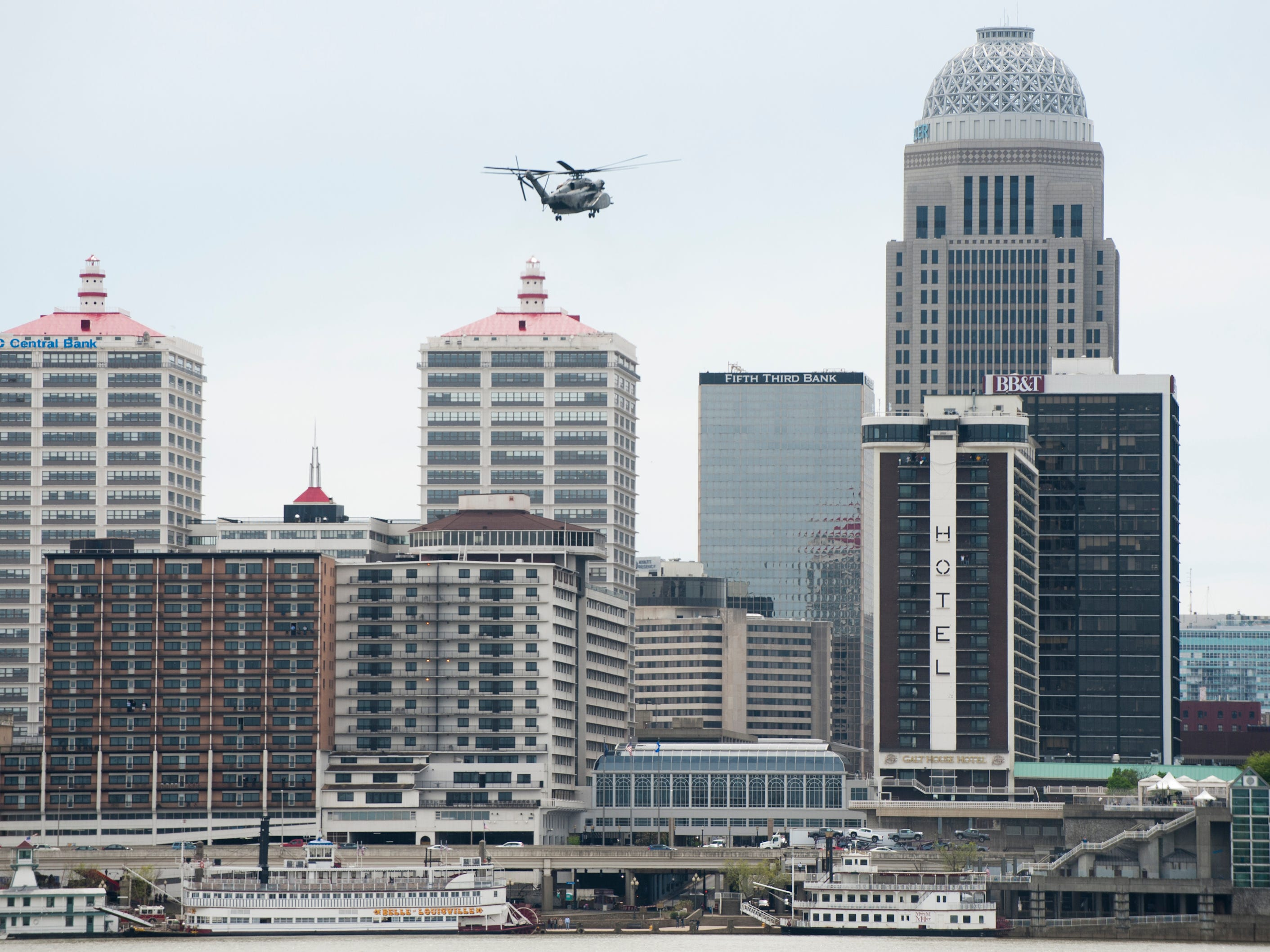 A U.S. Navy Vanguard helicopter hovers over the Louisville skyline as it practices for the air show.12 April 2019