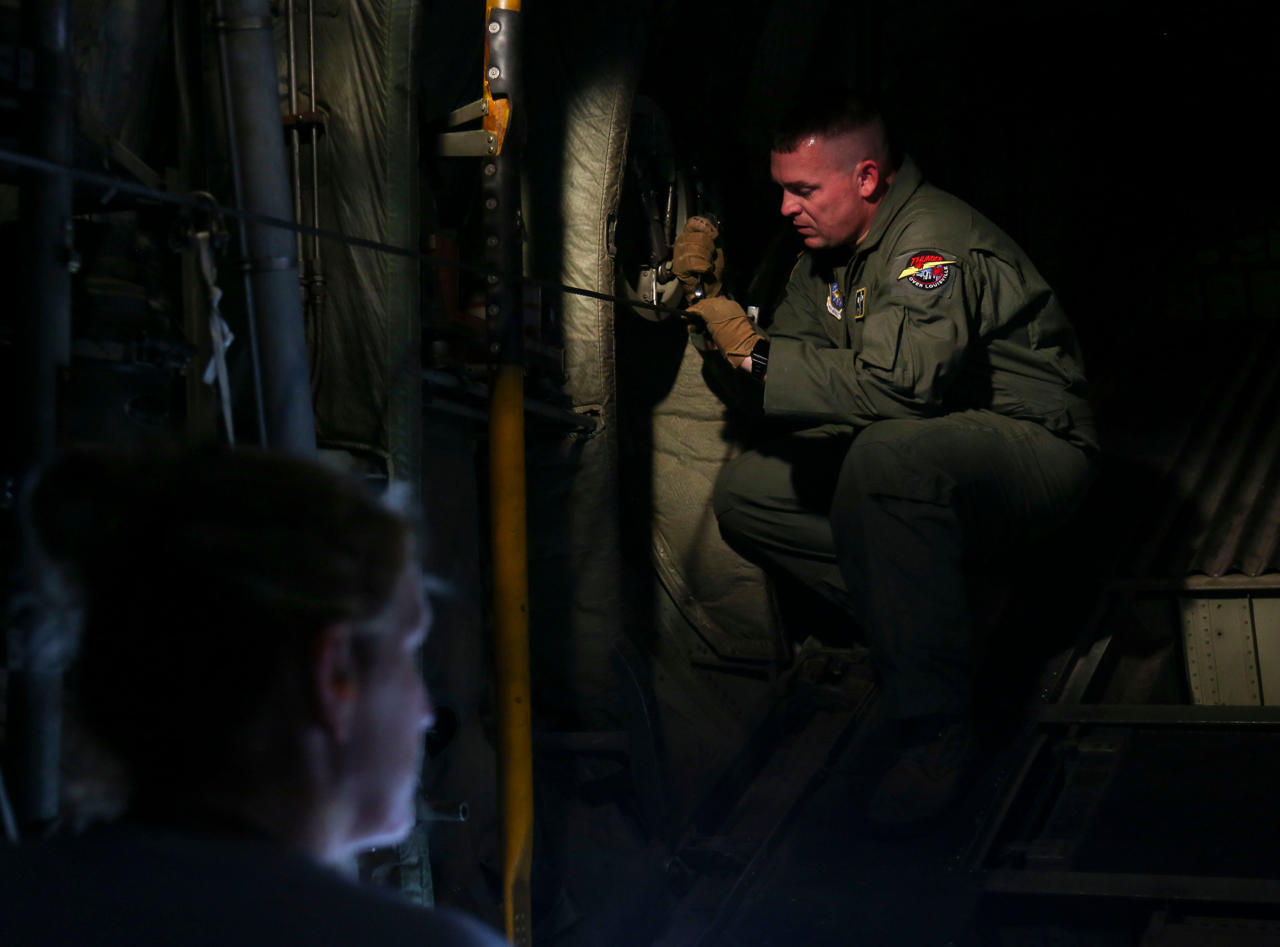 Master Sargent Drew Poynter, left, and Senior Master Sergeant Cynthia Benskin, right, prepare a C-130 Hercules, a four-engine, turboprop military transport aircraft, at the Kentucky Air National Guard ahead of practice for Thunder Over Louisville in Louisville, Ky. on Friday, April 12, 2019.