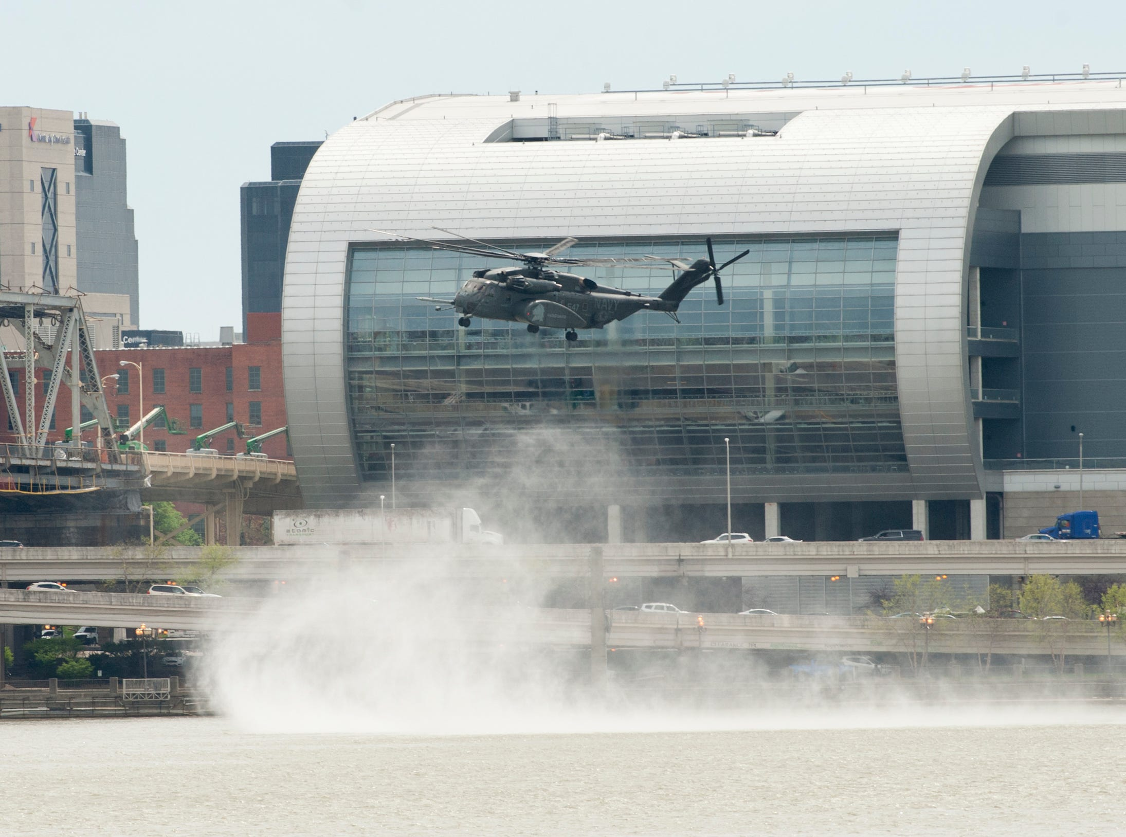 A U.S. Navy Vanguard helicopter hovers over the Second Street Bridge as it practices for the airshow. 12 April 2019
