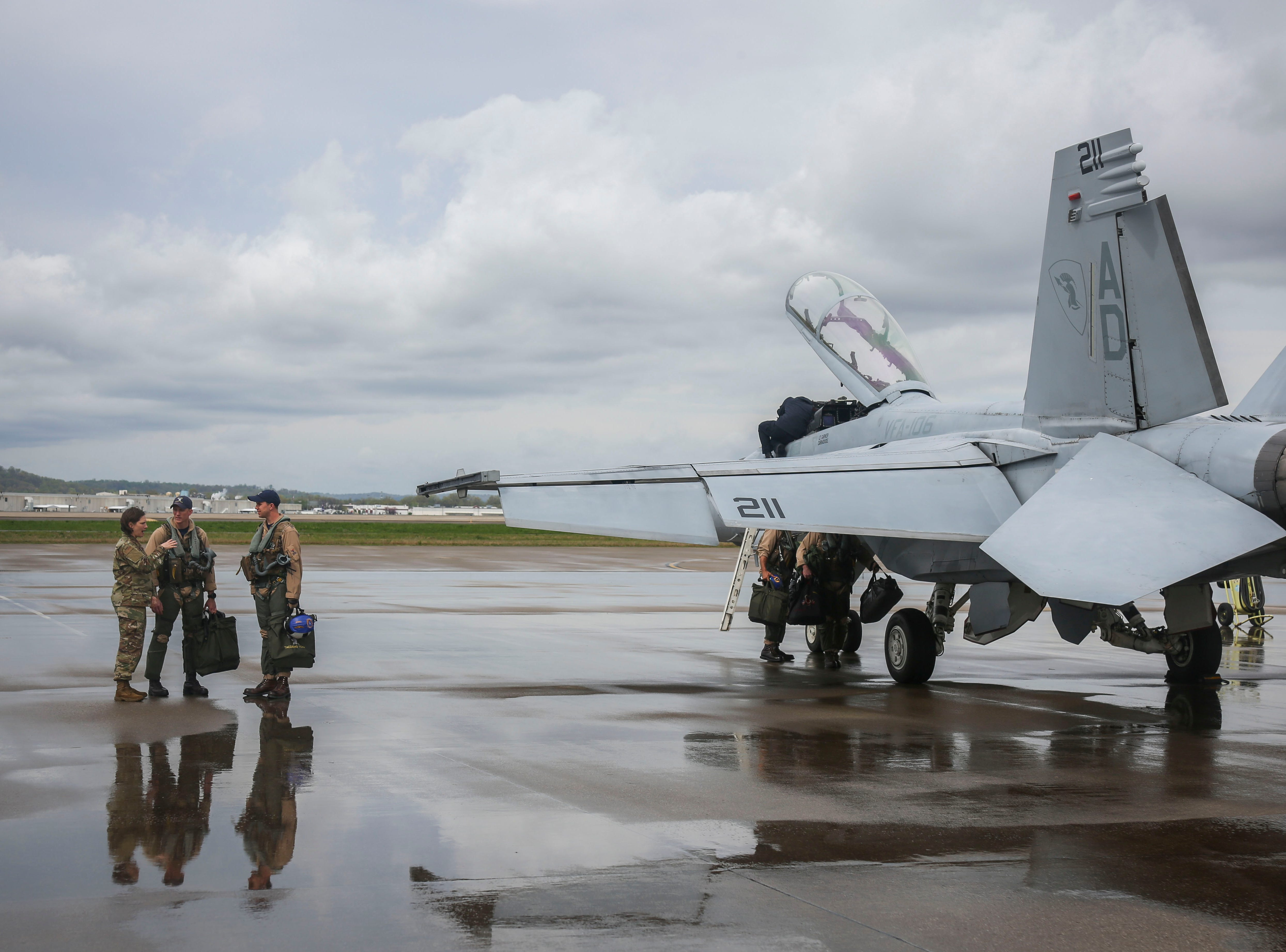 Crews service a F/A-18 Hornets, twin-engine, supersonic combat jets, at the Kentucky Air National Guard base ahead of practice for Thunder Over Louisville in Louisville, Ky. on Friday, April 12, 2019.
