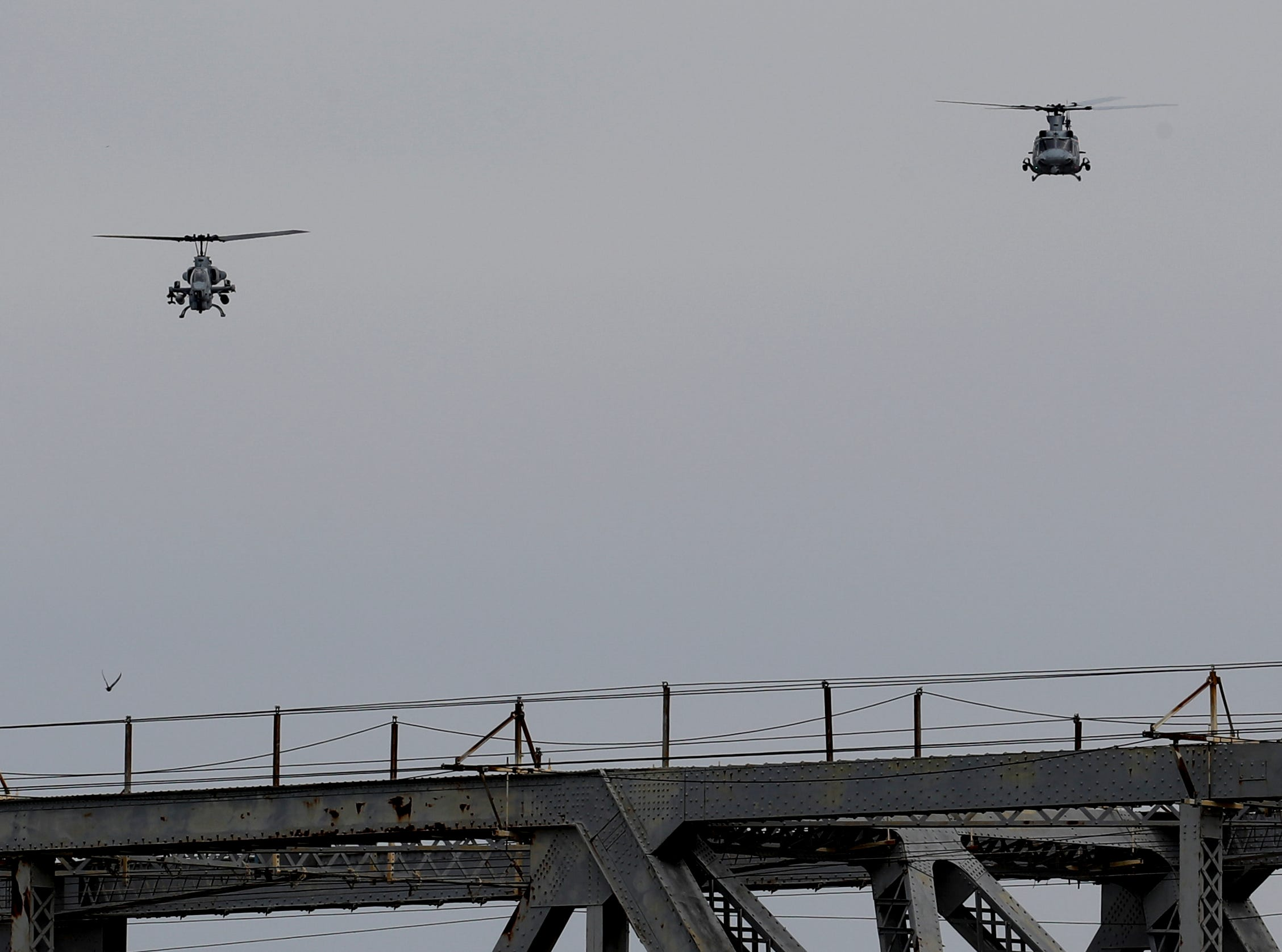 Helicopters practice in downtown Louisville on April 12 in preparation for the big Thunder Over Louisville airshow on Saturday.