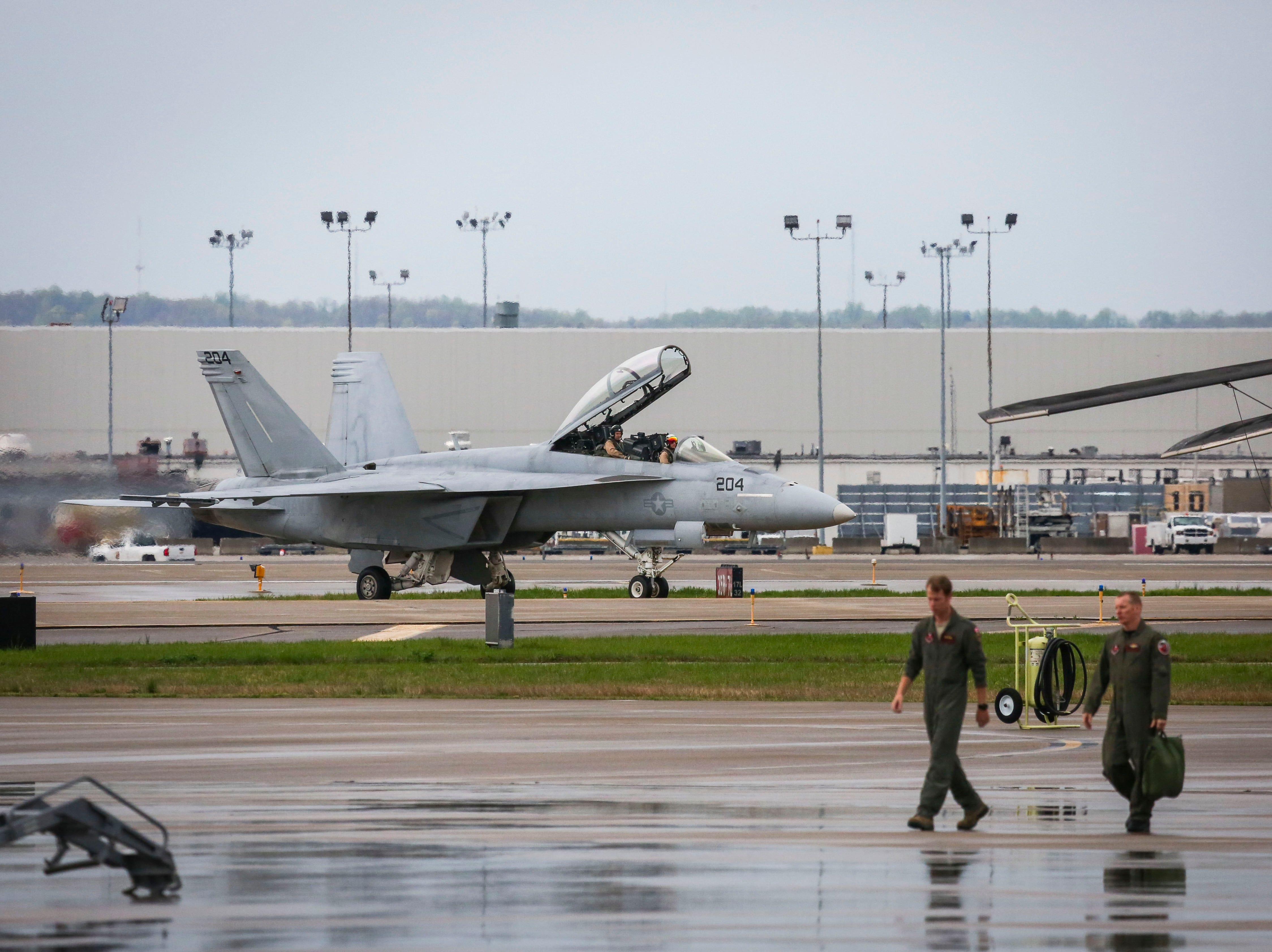 A F/A-18 Hornet, a twin-engine, supersonic combat jet, taxis on the runway of the Kentucky Air National Guard ahead of practice for Thunder Over Louisville in Louisville, Ky. on Friday, April 12, 2019.