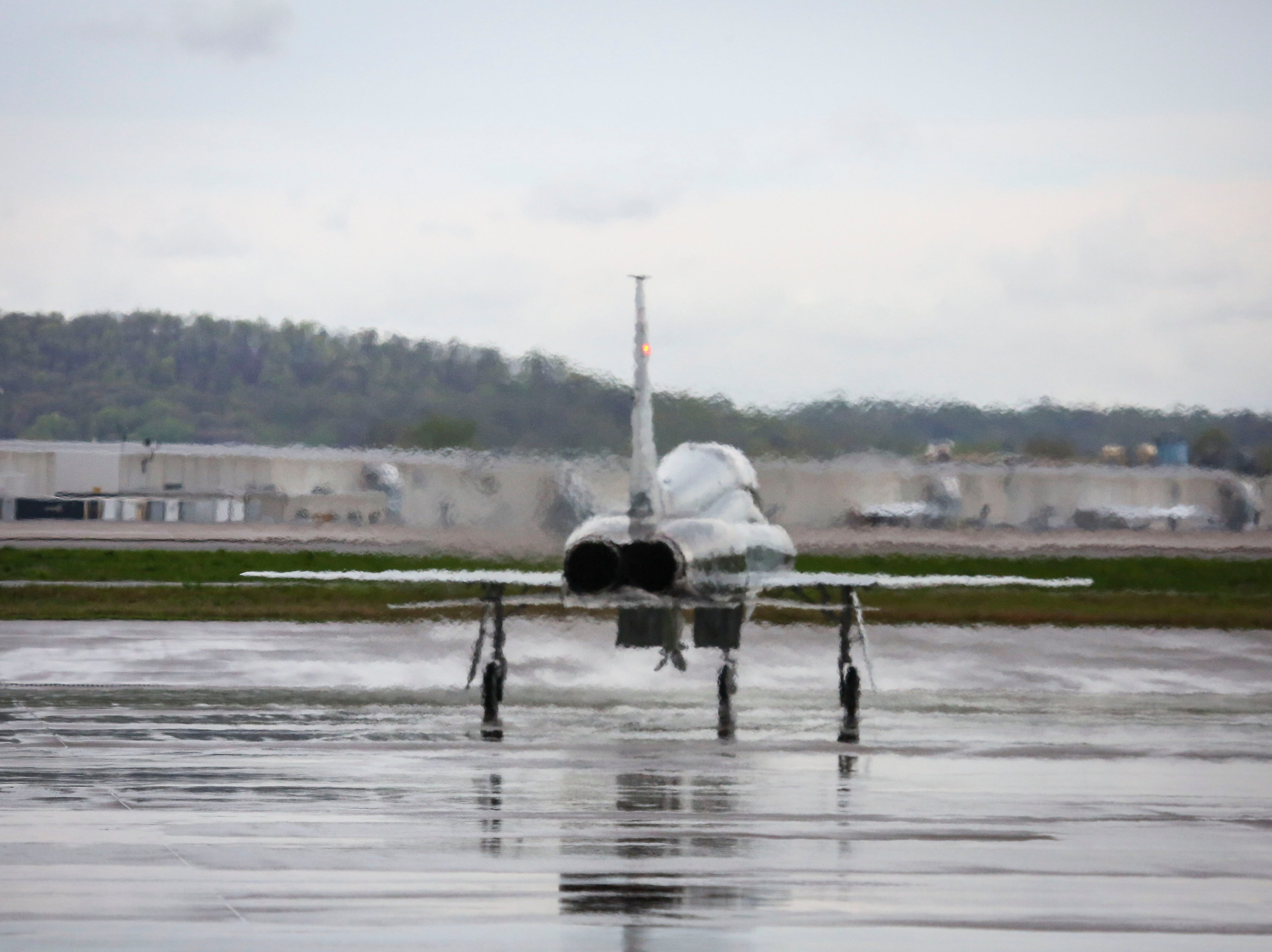 A T-38 Talon, a twinge supersonic jet trainer, taxis on the runway at the Kentucky Air National Guard ahead of practice for Thunder Over Louisville in Louisville, Ky. on Friday, April 12, 2019.
