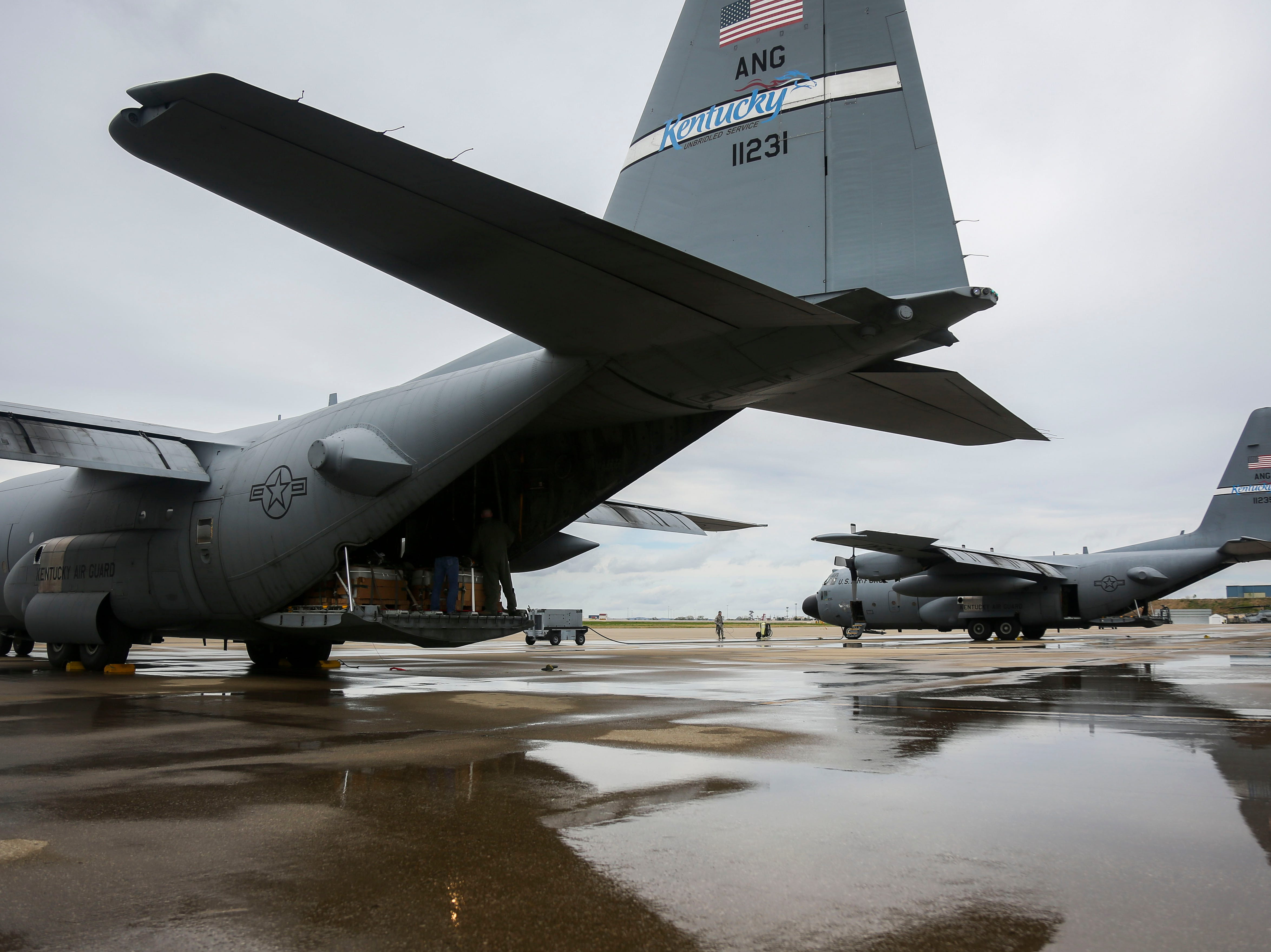 A C-130 Hercules, a four-engine, turboprop military transport aircraft, is prepared for a cargo drop on the runway of the Kentucky Air National Guard ahead of practice for Thunder Over Louisville in Louisville, Ky. on Friday, April 12, 2019.