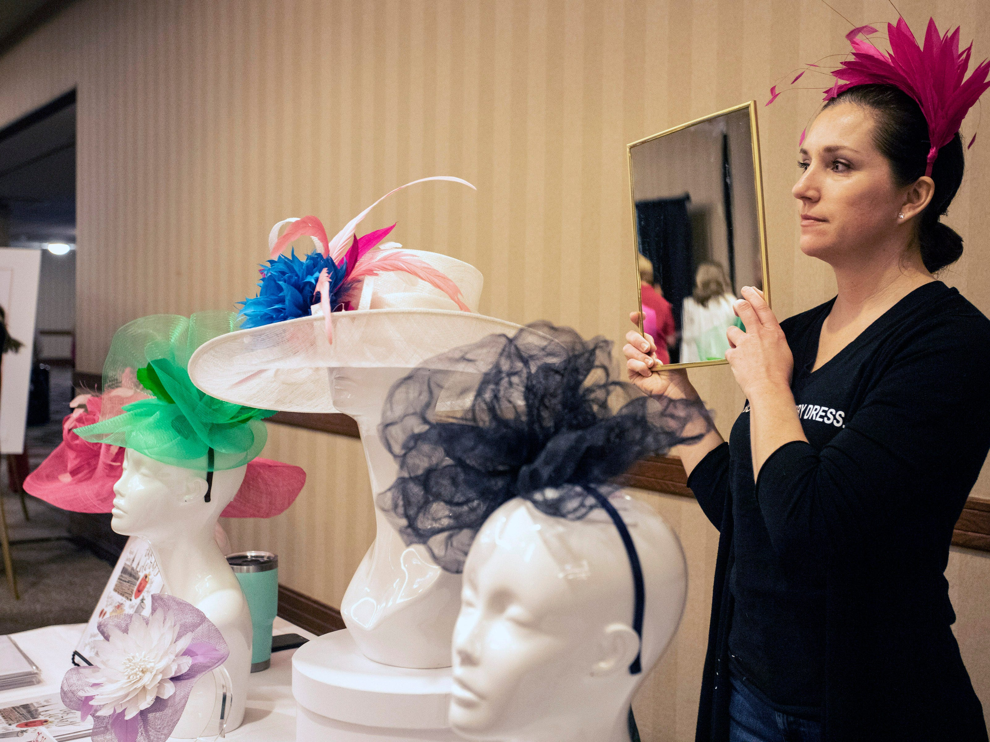 Rachel Bell of The Hat Girls helped customers try on popular Derby looks during the KDF They're Off! Luncheon on Friday. 4/12/19
