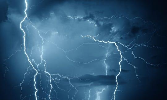 Lightning during storm on dark summer night.