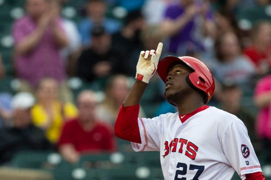 Louisville Bat right fielder Aristides Aquino points to the sky after a home run during the Louisville Bats opening night at Louisville Slugger Stadium. April 11, 2019