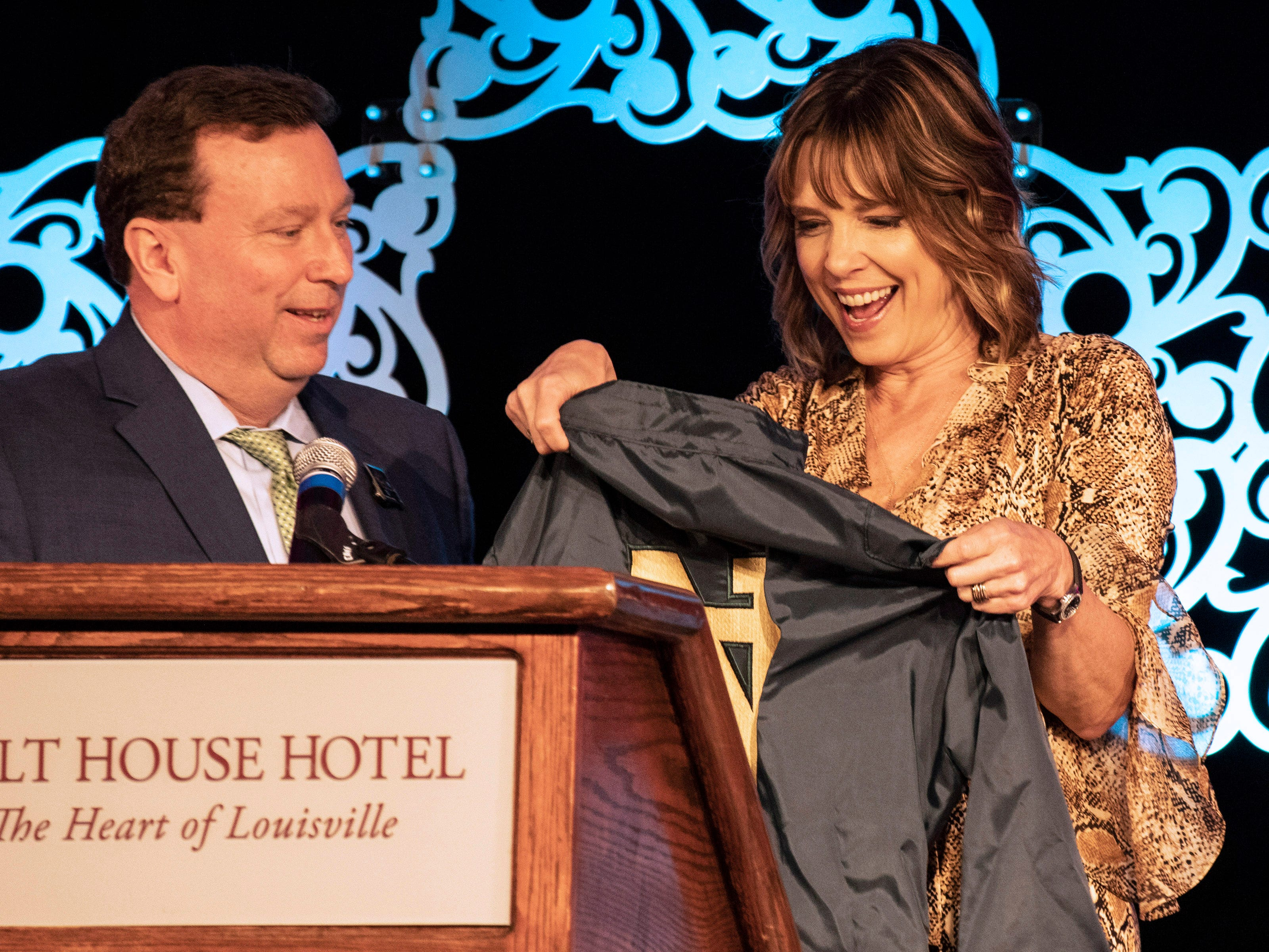 Churchill Downs president Kevin Flanery presented Hannah Storm with jockey silks in the colors of the Fighting Irish during the KDF They're Off! Luncheon on Friday. Storm graduated from Notre Dame in 1983 and lived in Louisville as a child. 4/12/19