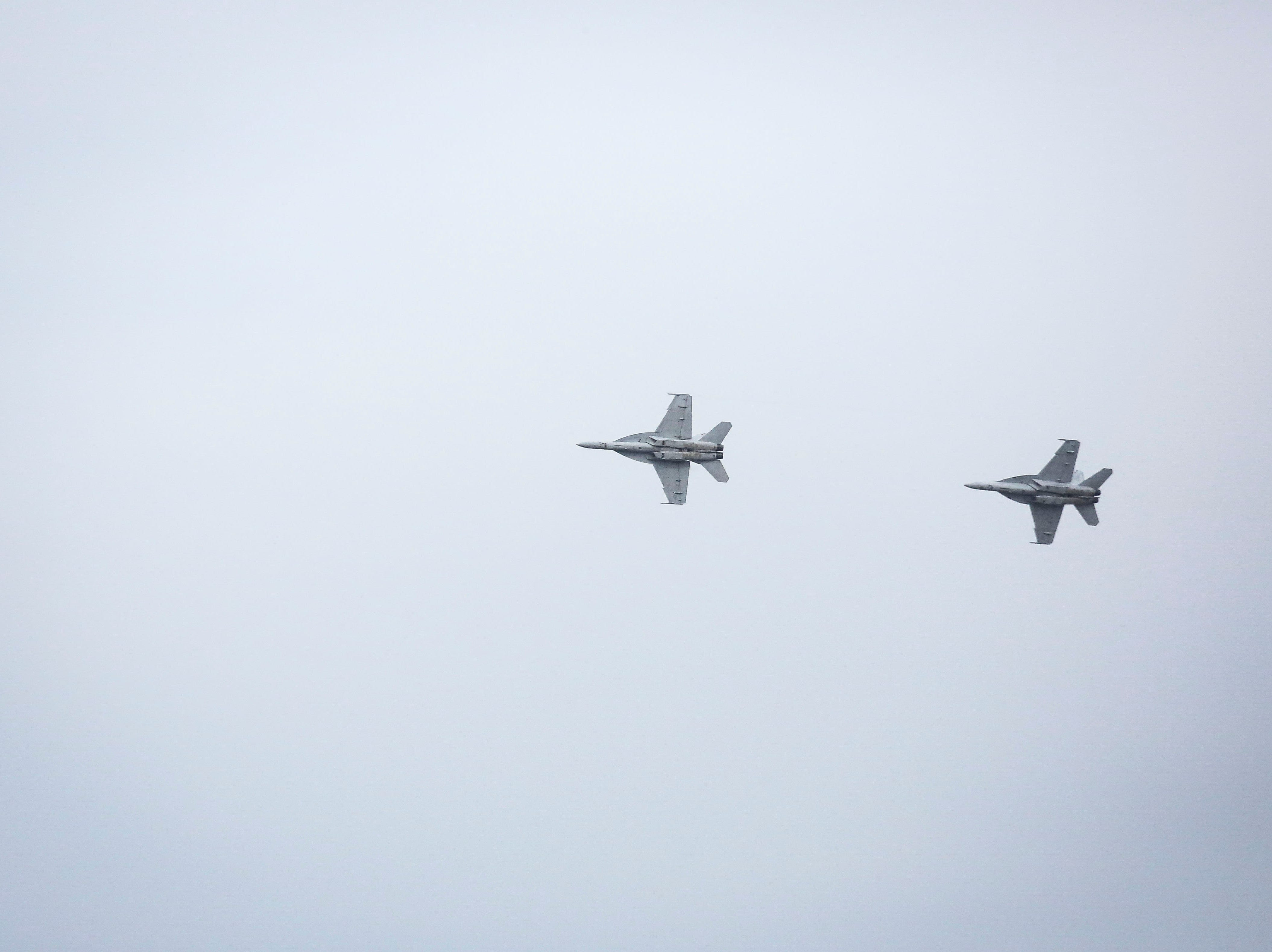 Two F/A-18 Hornets, twin-engine, supersonic combat jets, fly over the Kentucky Air National Guard base ahead of practice for Thunder Over Louisville in Louisville, Ky. on Friday, April 12, 2019.