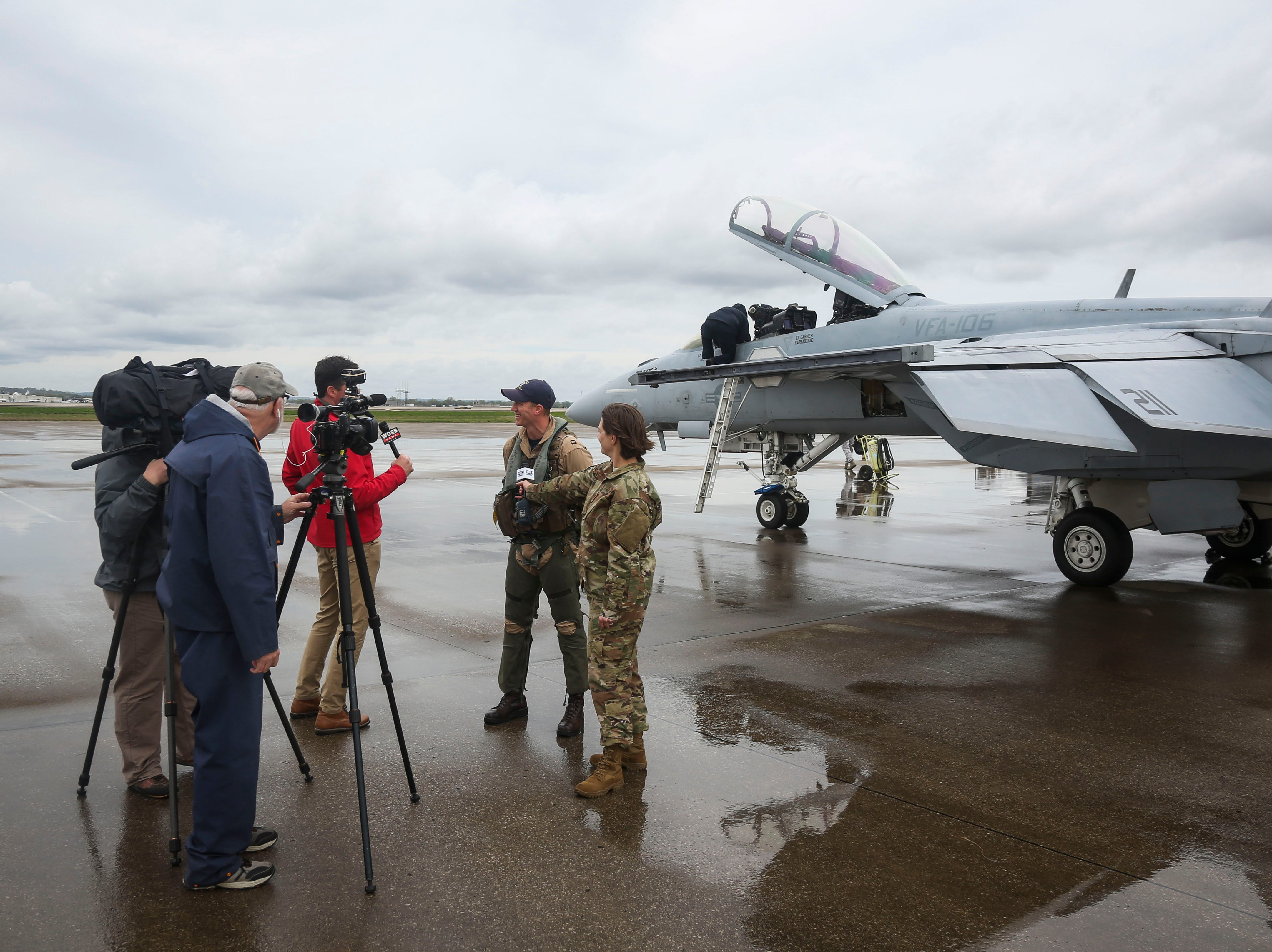 Lt. Jeff Mayer speaks to members of the media after landing a F/A-18 Hornet, a twin-engine, supersonic combat jet, on the runway of the Kentucky Air National Guard ahead of practice for Thunder Over Louisville in Louisville, Ky. on Friday, April 12, 2019.