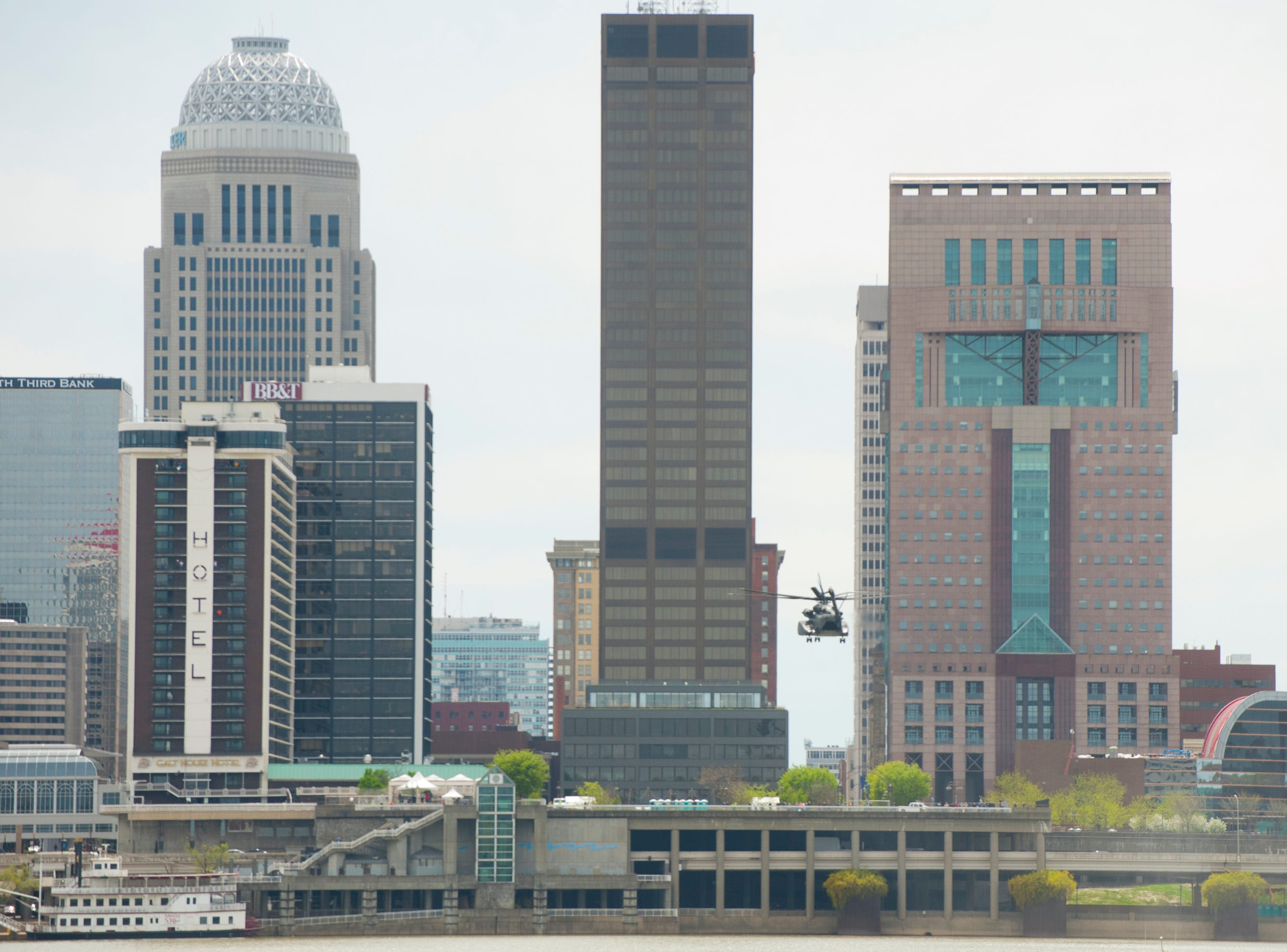 A U.S. Navy Vanguard helicopter hovers over the Louisville skyline as it practices for the airshow. 12 April 2019