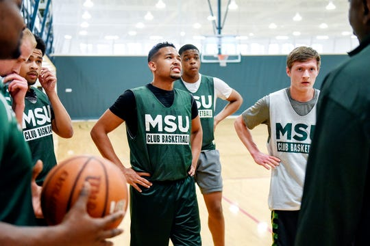 Robert Ray Jr., center, listens to the club basketball team coach during a practice on Friday, March 30, 2019, at IM Sports East on the Michigan State University campus in East Lansing.