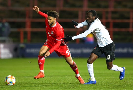 Nathan Lewis (right), shown here playing for Trinidad and Tobago in an international friendly vs. Wales on March 20, signed with Lansing Ignite in January and reported to the team last week after his work permit issues prevented him from joining team at the beginning of preseason camp.