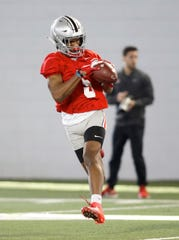 Ohio State receiver Garrett Wilson makes a catch during spring drills.