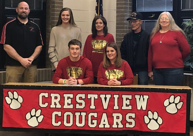Crestview's Jacob Greer (front, left) signs to play college football at Otterbein University fulfilling a promise he made to his late step-father Jimi Walker.