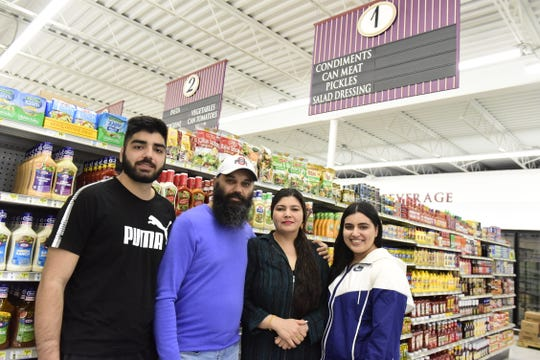 The KV Market at 359 W. Fourth St. is scheduled to open Thursday. Owners and family members are, from left, Dalip Singh Bhullar, Karamjit Singh Bhullar, Varinder Kaur Bhullar and Avneet Kaur Bhullar.