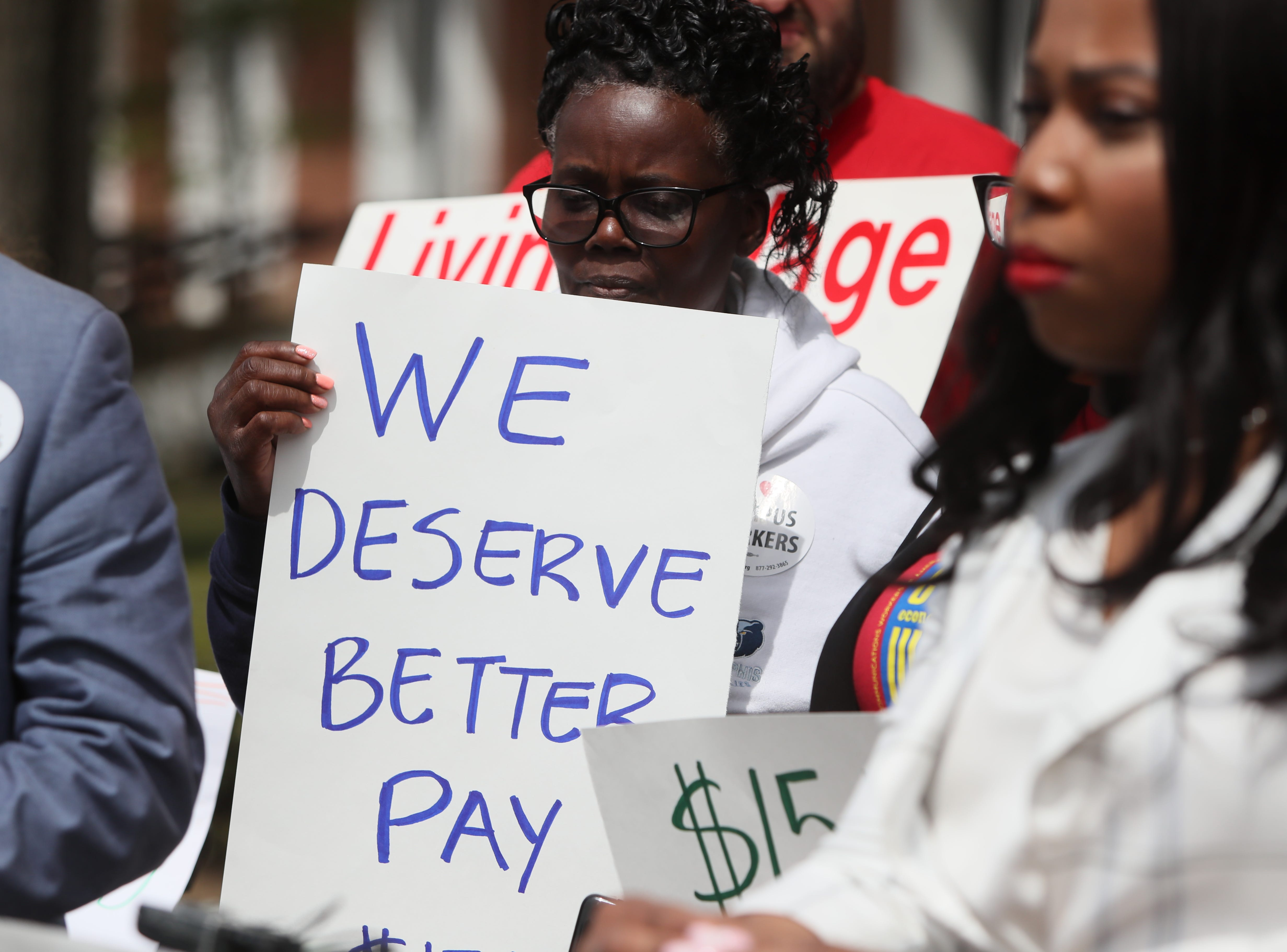 People gather for a press conference to address implementing a $15 minimum hourly wage for all campus employees at the University of Memphis on Friday, April 12, 2019.