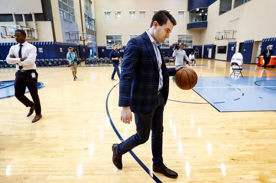 Zach Kleiman, the Memphis Grizzlies' new executive VP of basketball operations dribbles a ball as he heads to an interview station after a portrait session during a press conference at the FedExFourm April 12, 2019