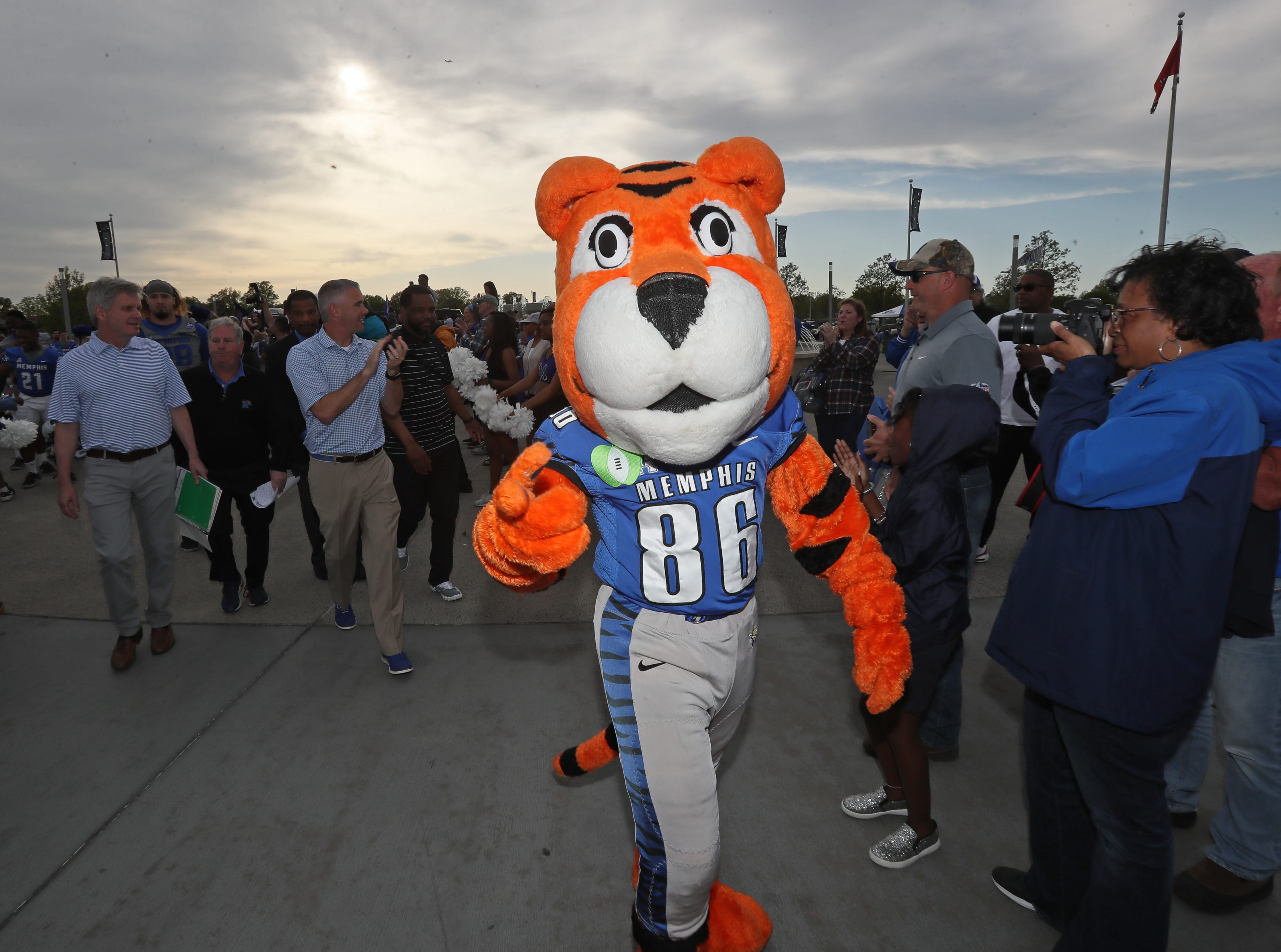 Tigers mascot Pouncer greets fans before their 'Friday Night Stripes' spring game at Liberty Bowl Memorial Stadium on Friday, April 12, 2019.