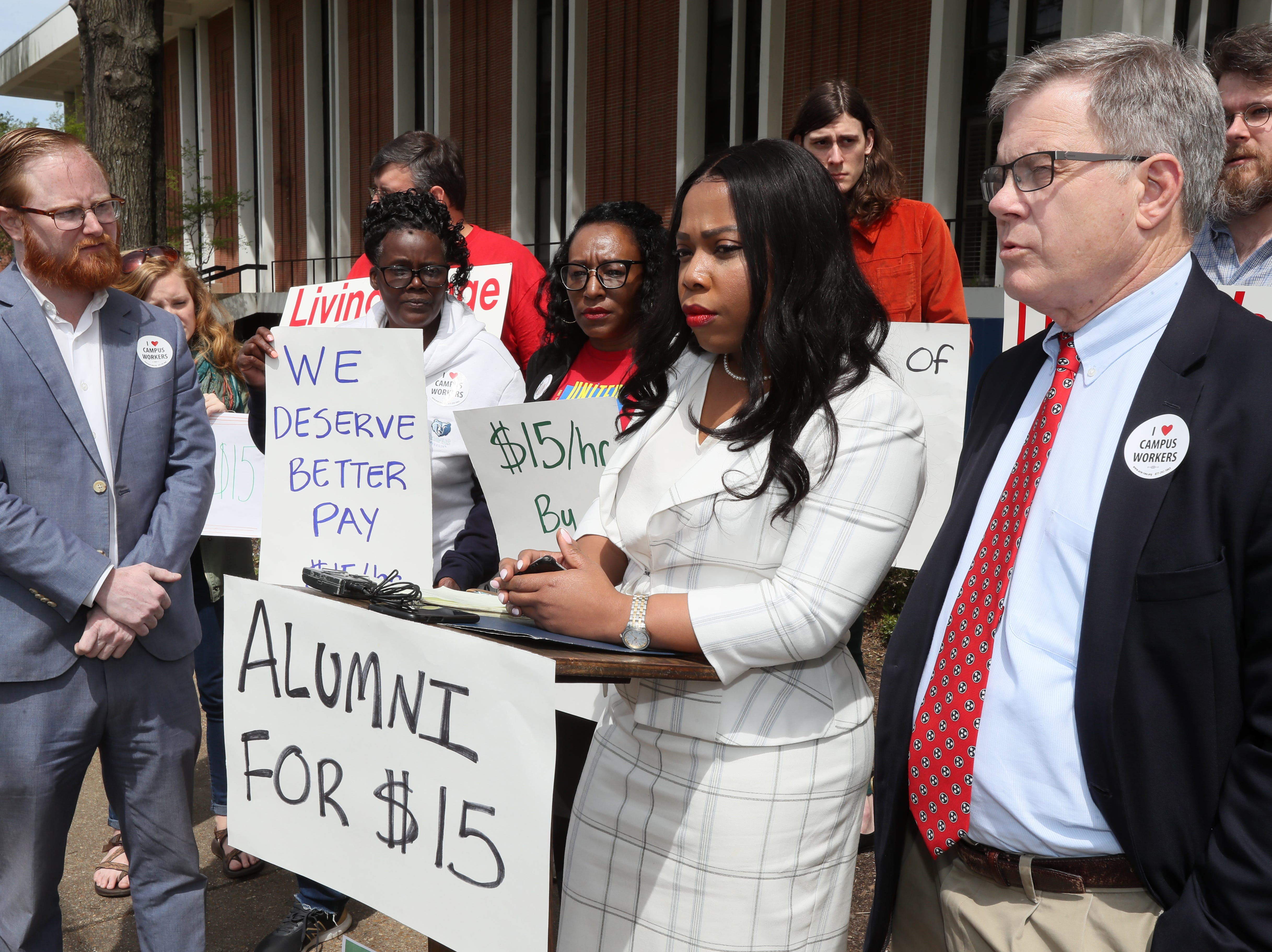 Allan Creasy, from left, Sen. Katrina Robinson and Rep. Dwayne Thompson speak during a press conference to address implementing a $15 minimum hourly wage for all campus employees at the University of Memphis on Friday, April 12, 2019.
