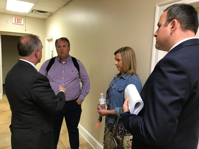 Lakeland Commissioners Josh Roman, Michele Dial and Wesley Wright speak with the city attorney after the city mayor, not pictured, says he's reported 'financial anomalies' to the state.