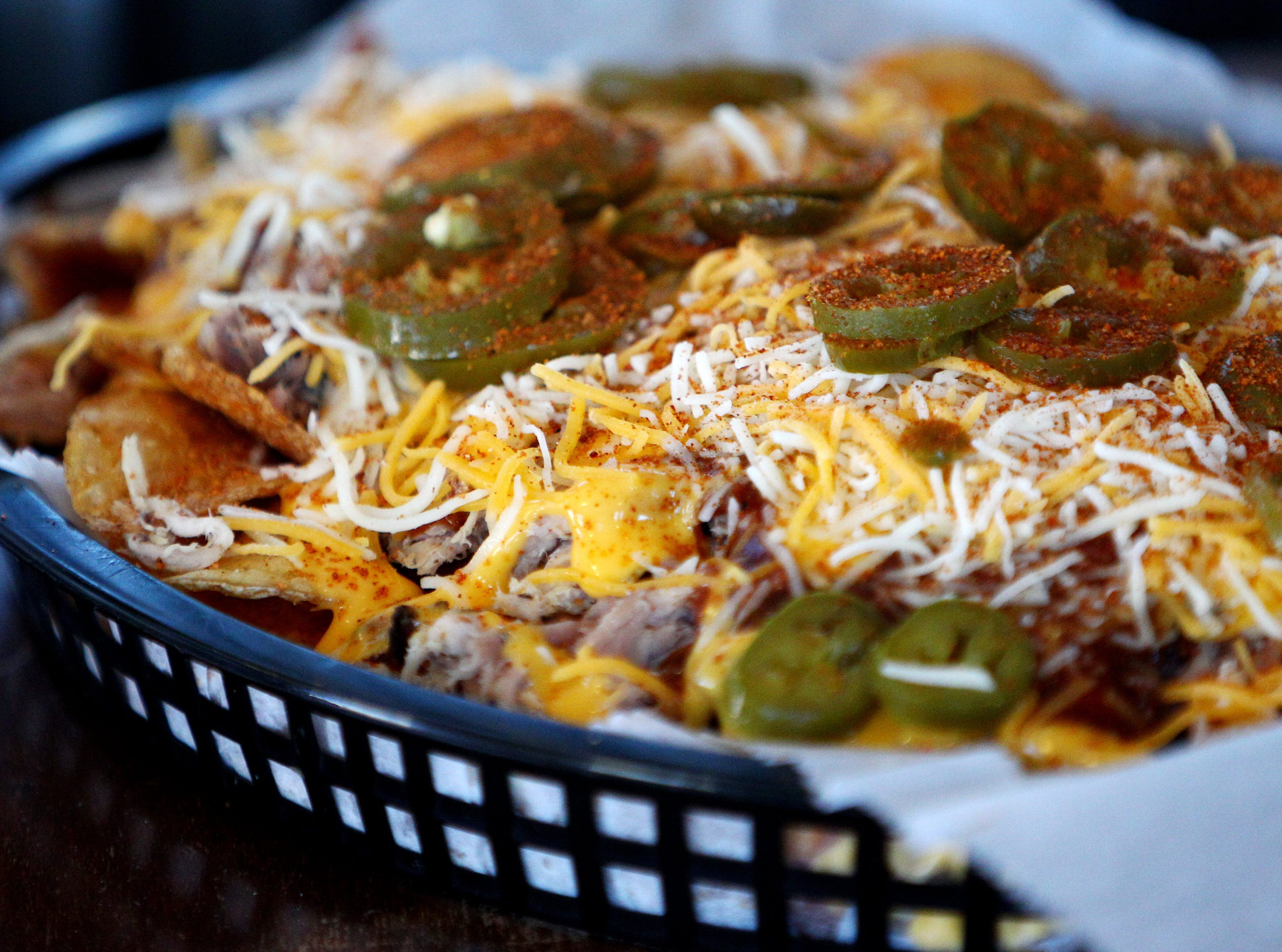 The bbq nachos at Central BBQ downtown can be served the traditional way on tortilla chips or on the homemade bbq chips on May 14, 2013.