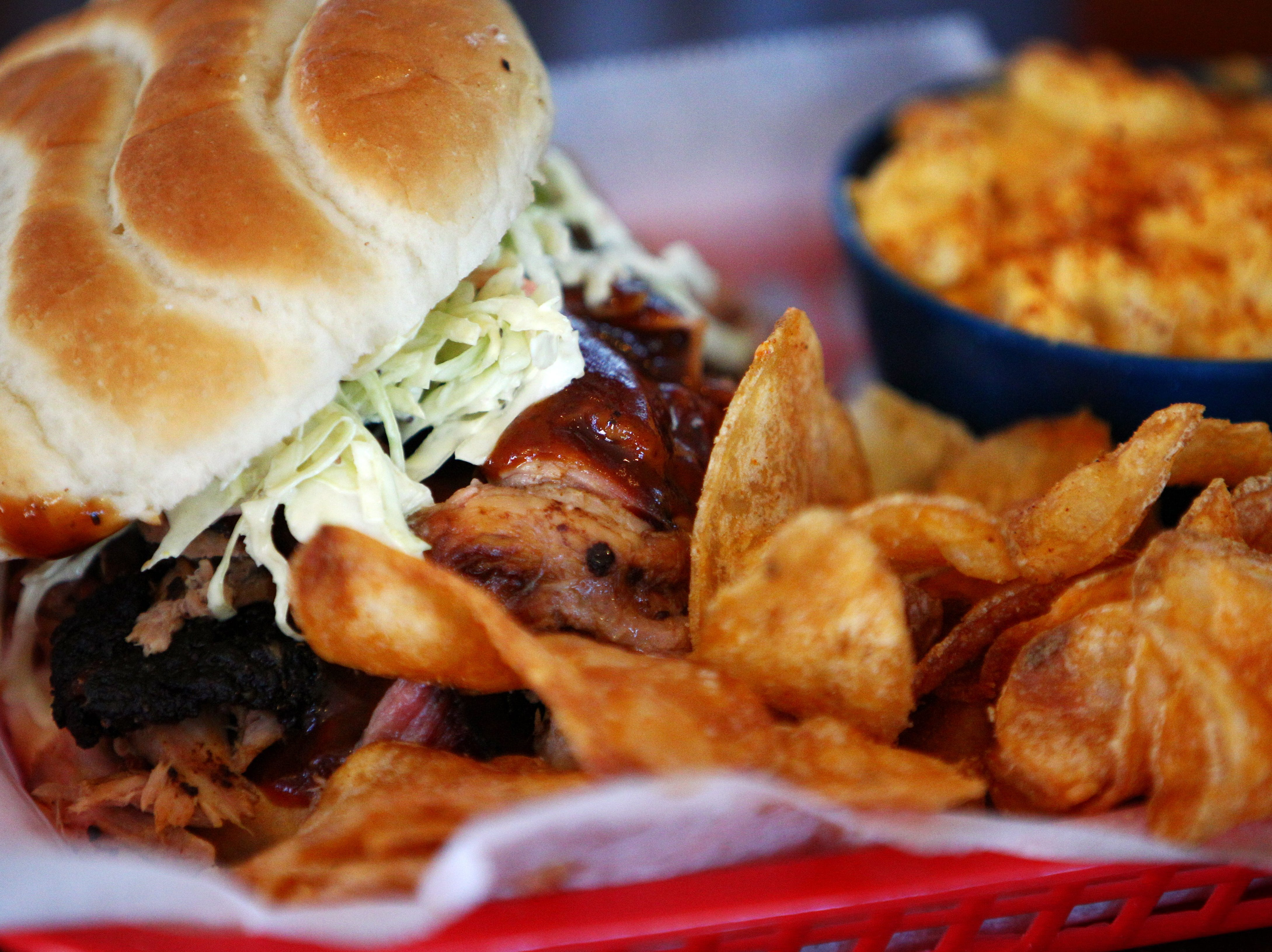 The jumbo pork sandwich with homemade barbecue chips and mac and cheese is a popular item at Central BBQ downtown on Butler behind the National Civil Rights Museum on May 14, 2013.