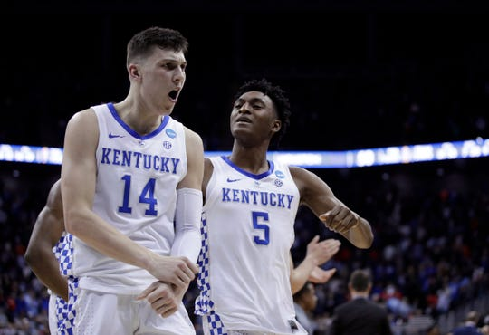 Kentucky's Tyler Herro (14) and Immanuel Quickley celebrate following a men's NCAA tournament college basketball Midwest Regional semifinal game against Houston Friday, March 29, 2019, in Kansas City, Mo. (AP Photo/Charlie Riedel) ORG XMIT: MOJR227