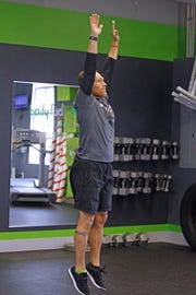 Eric Gramza shows the final movement of the burpee, the vertical leap.