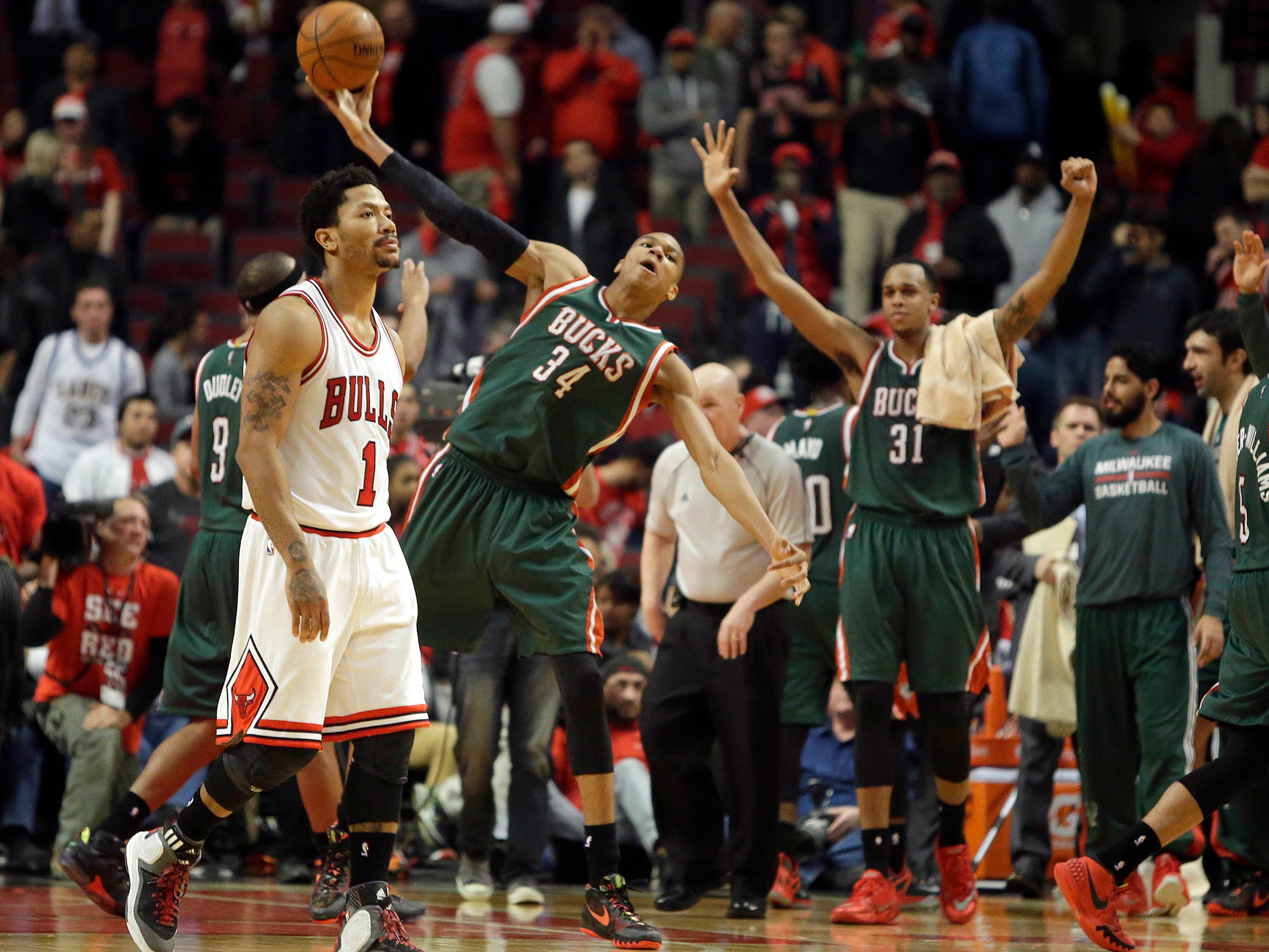 2015: As time expires, Milwaukee Bucks forward Giannis Antetokounmpo (center) hurls the ball as Chicago Bulls guard Derrick Rose (left) walks off the court after the Bucks' 94-88 win over the Chicago Bulls in the first-round Eastern Conference playoff game  at the United Center in Chicago on April 27, 2015. The Bulls wound up eliminating the Bucks in six games.