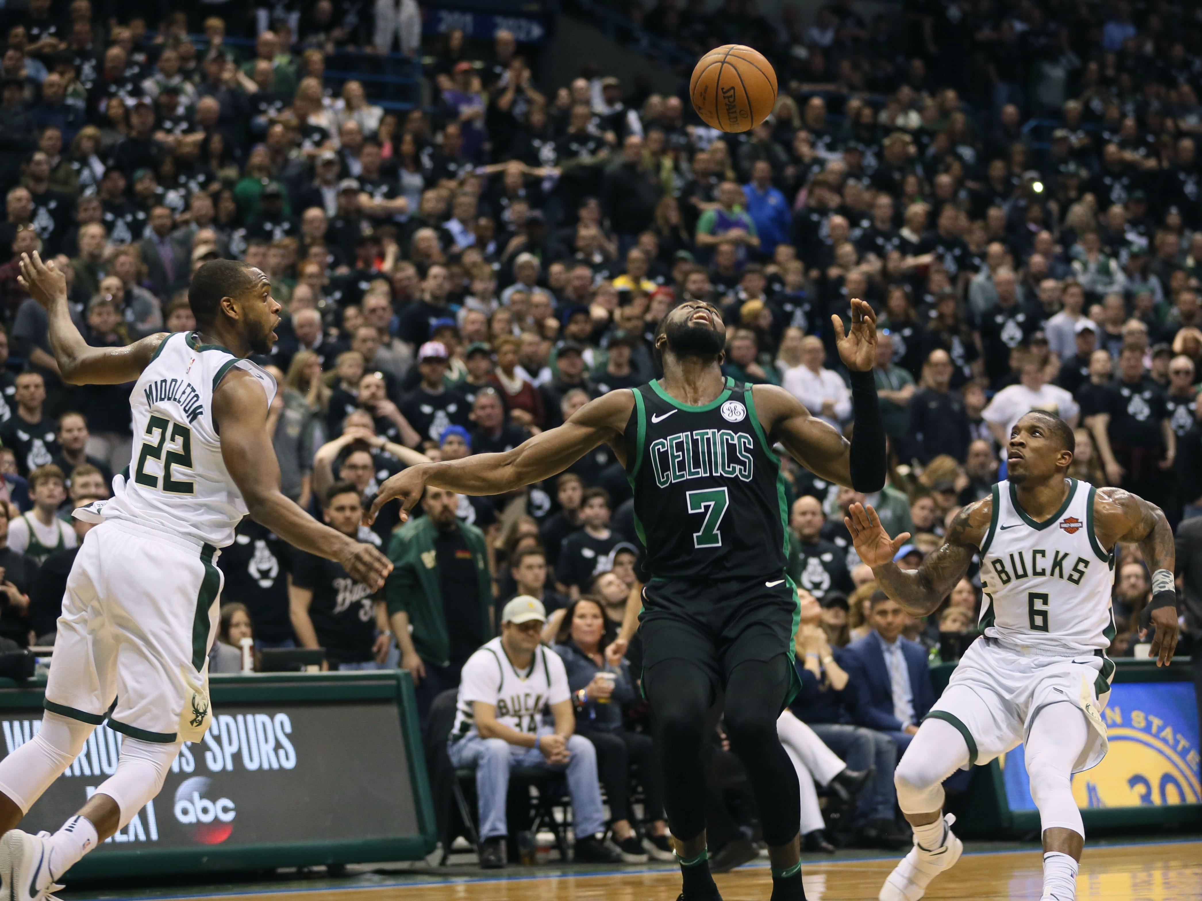 2018: Bucks Khris Middleton (left) and Eric Bledsoe (right) move in on the ball as Boston Celtic Jaylen Brown loses control of it during a rebound during Game 4 of the first round of the Eastern Conference playoffs on April 22, 2018. The Bucks won Game 4, 104-102, but lost the series to the Celtics in seven games.